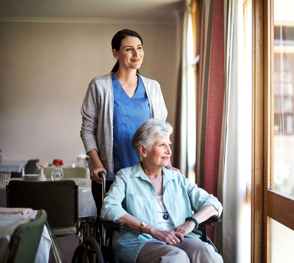 Nurse with Senior Resident at Seven Lakes Memory Care in Loveland, Colorado