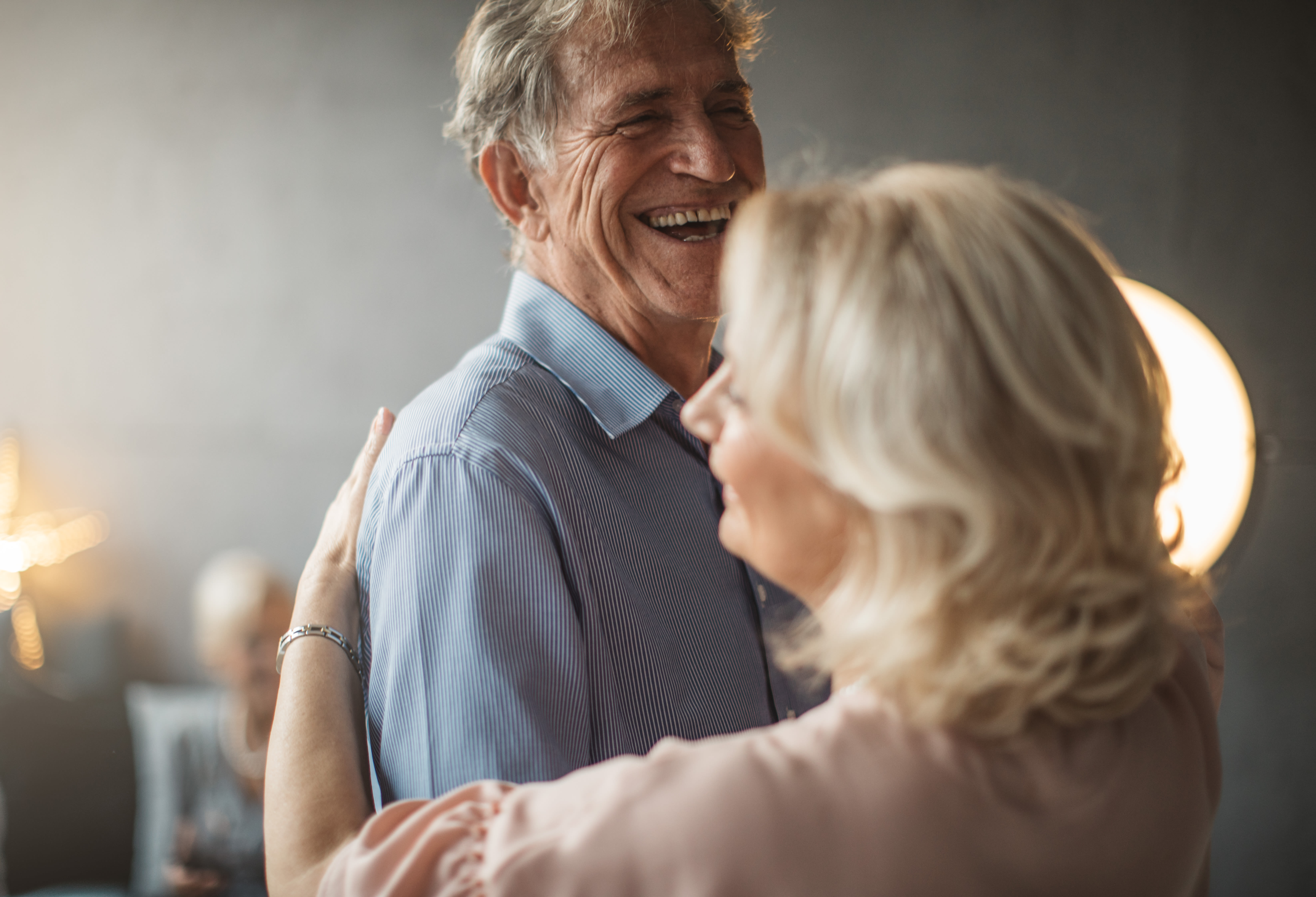 A resident couple dance in their kitchen at Broadwell Senior Living in Kearney, Nebraska