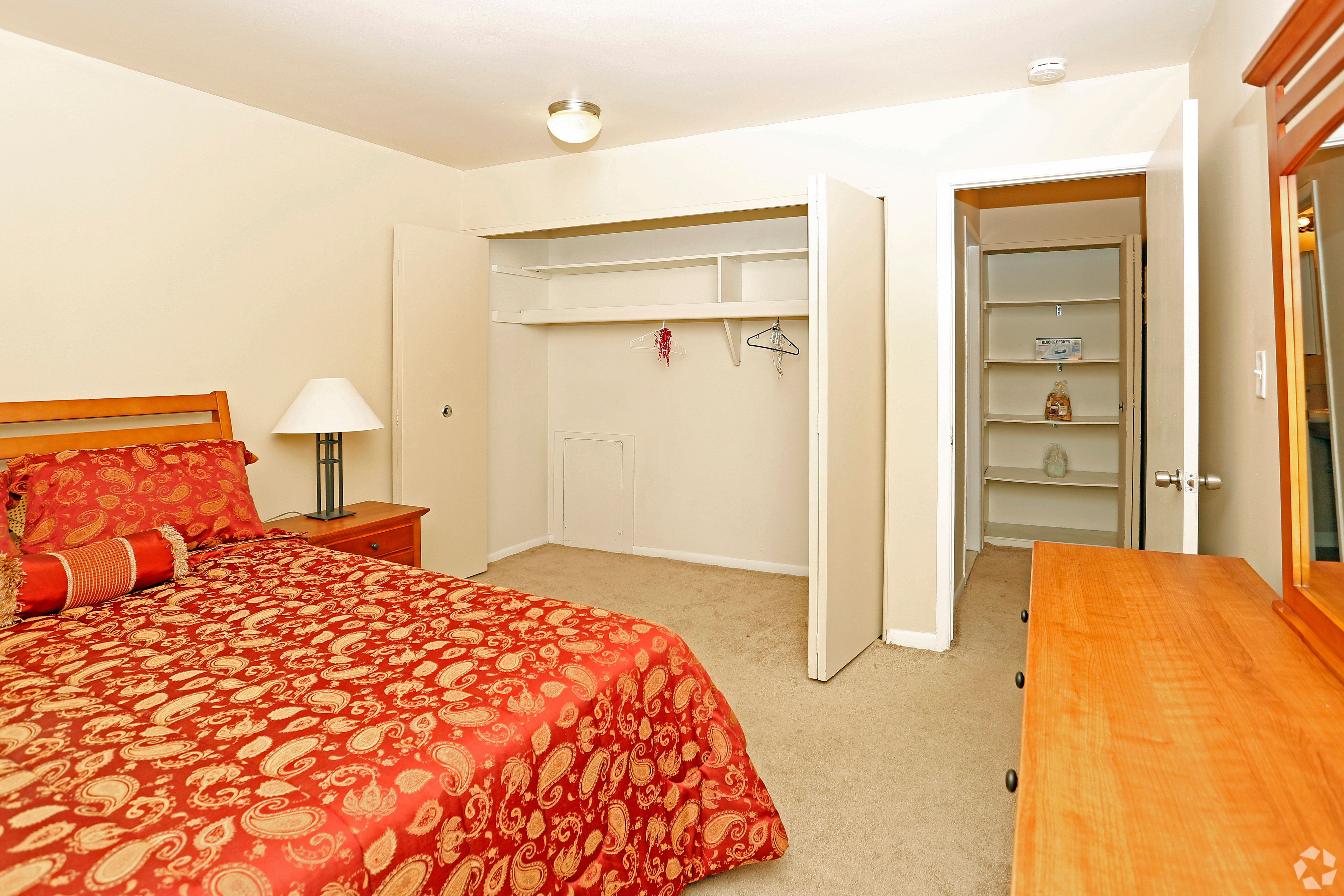 Clean bedroom at Hoover Square Apartments in Warren, Michigan