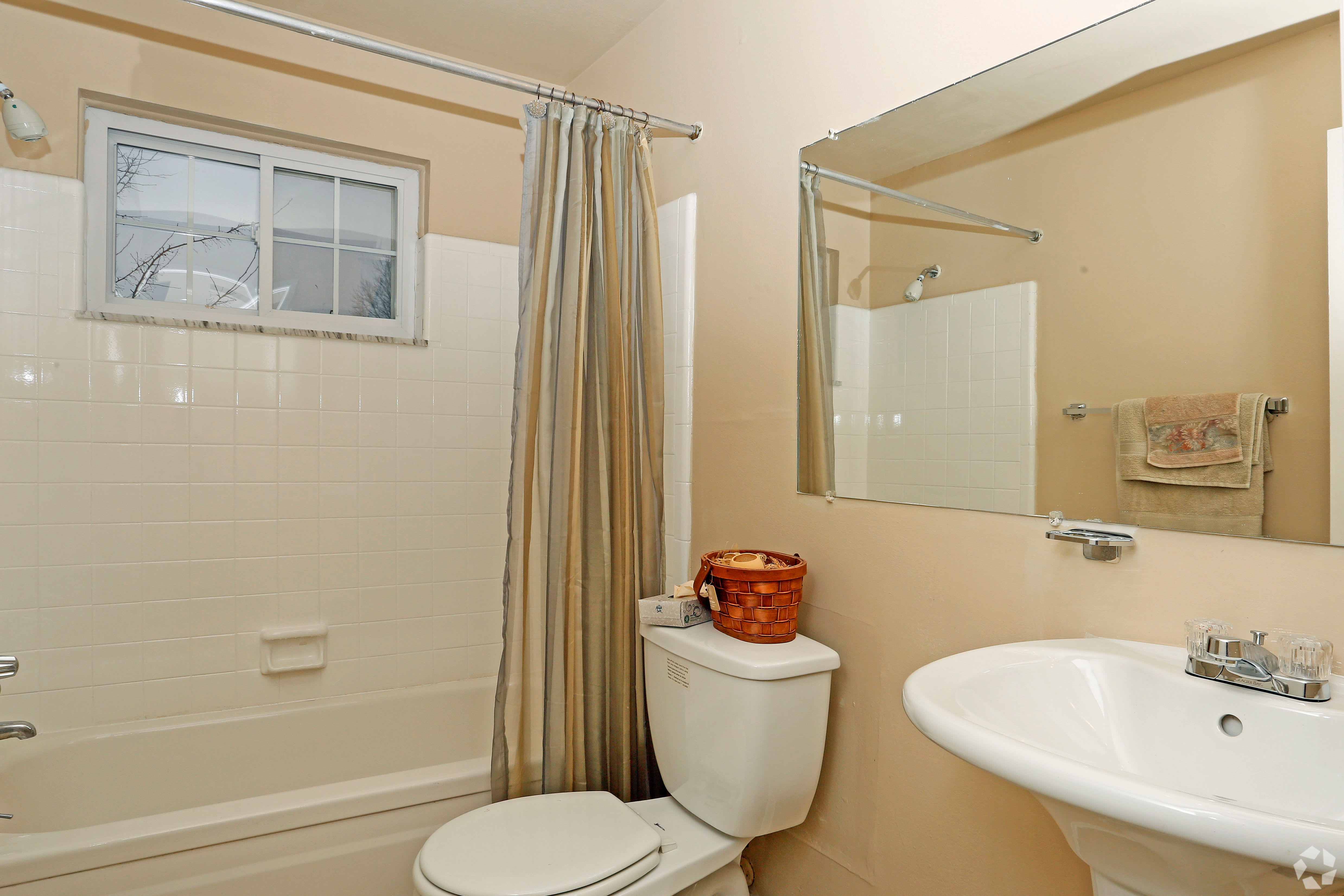 Hoover Square Apartments offers a modern bathroom at Hoover Square Apartments in Warren, Michigan