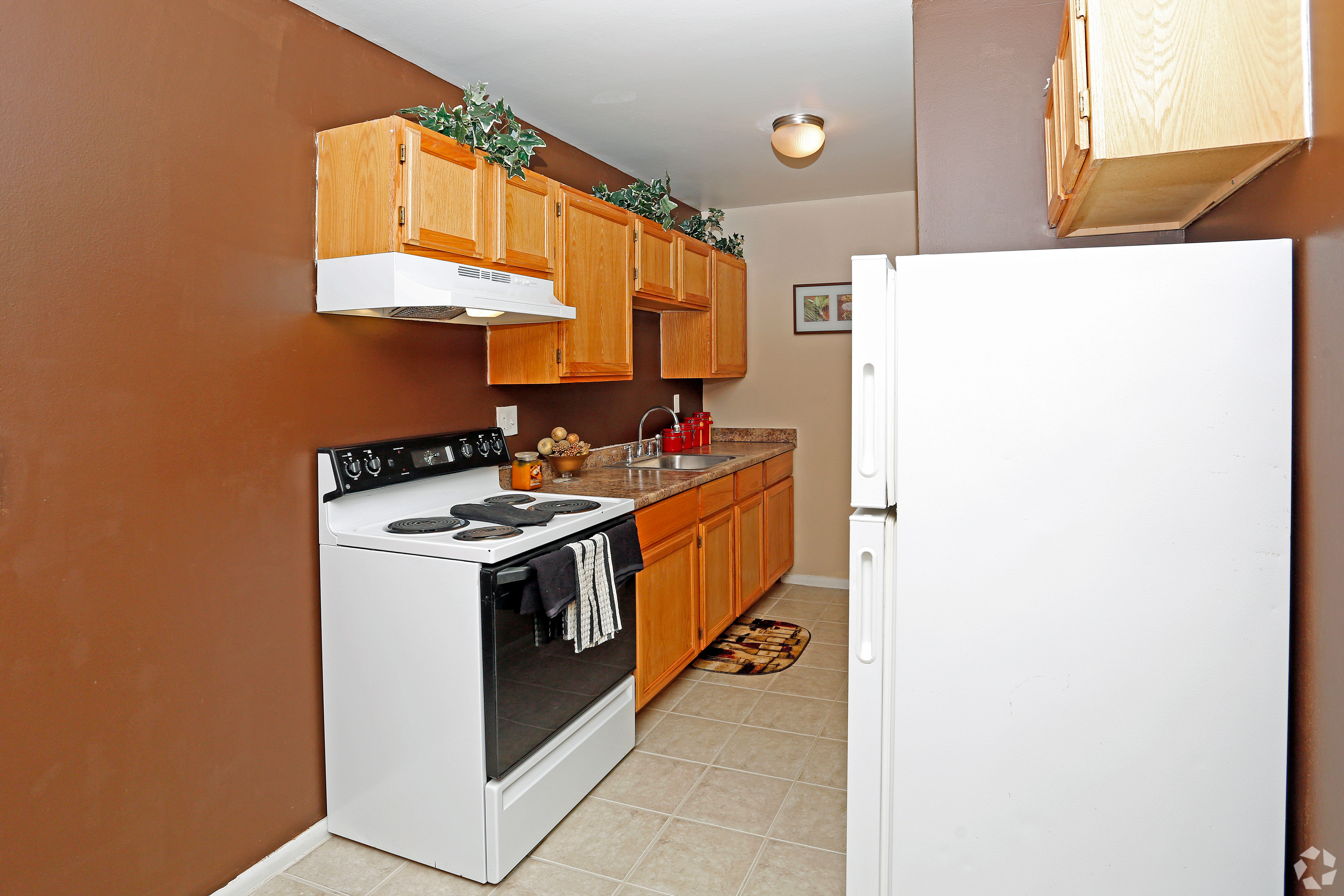 Well-equipped kitchen at Hoover Square Apartments in Warren, Michigan
