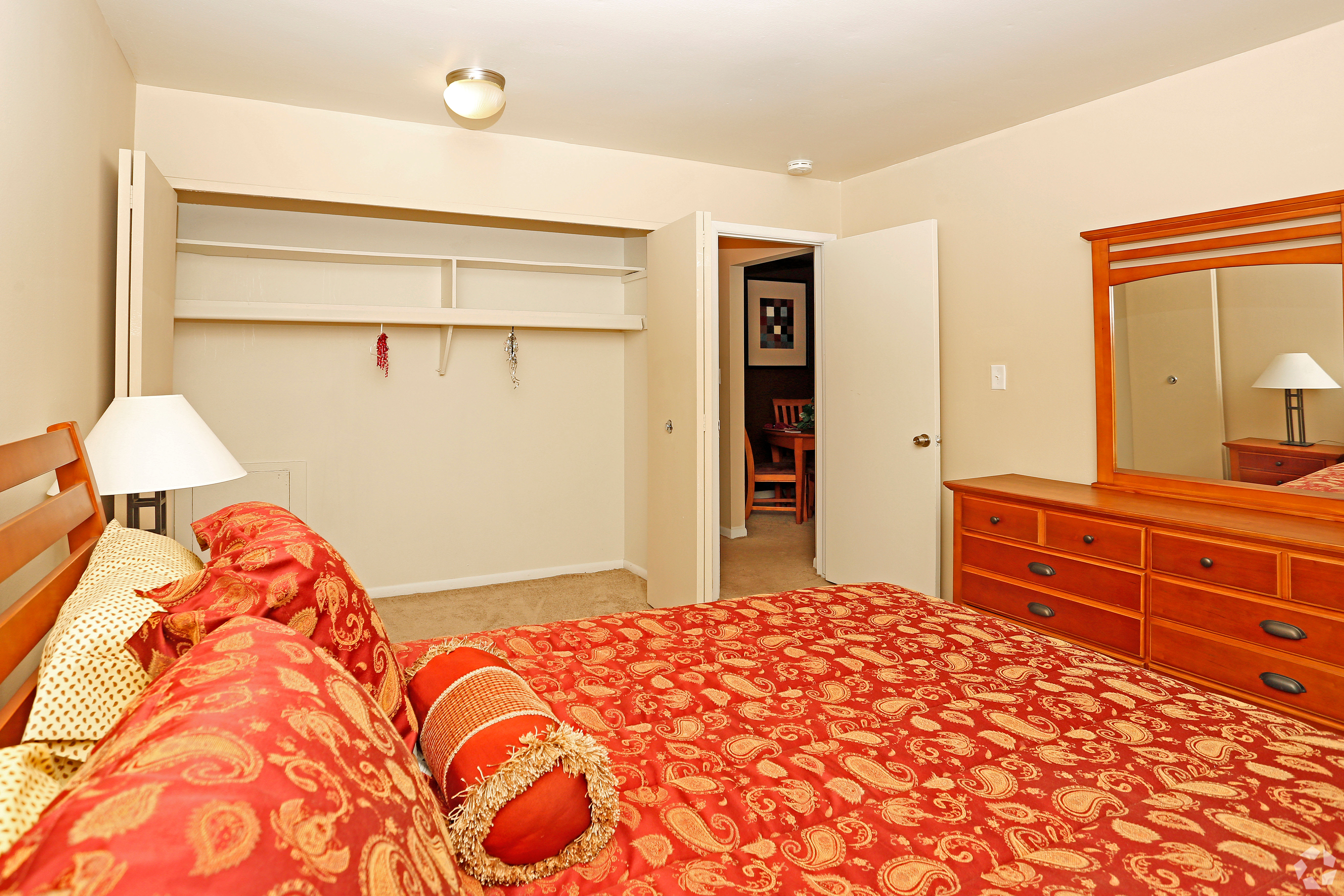Enjoy a spacious bedroom at Hoover Square Apartments in Warren, Michigan