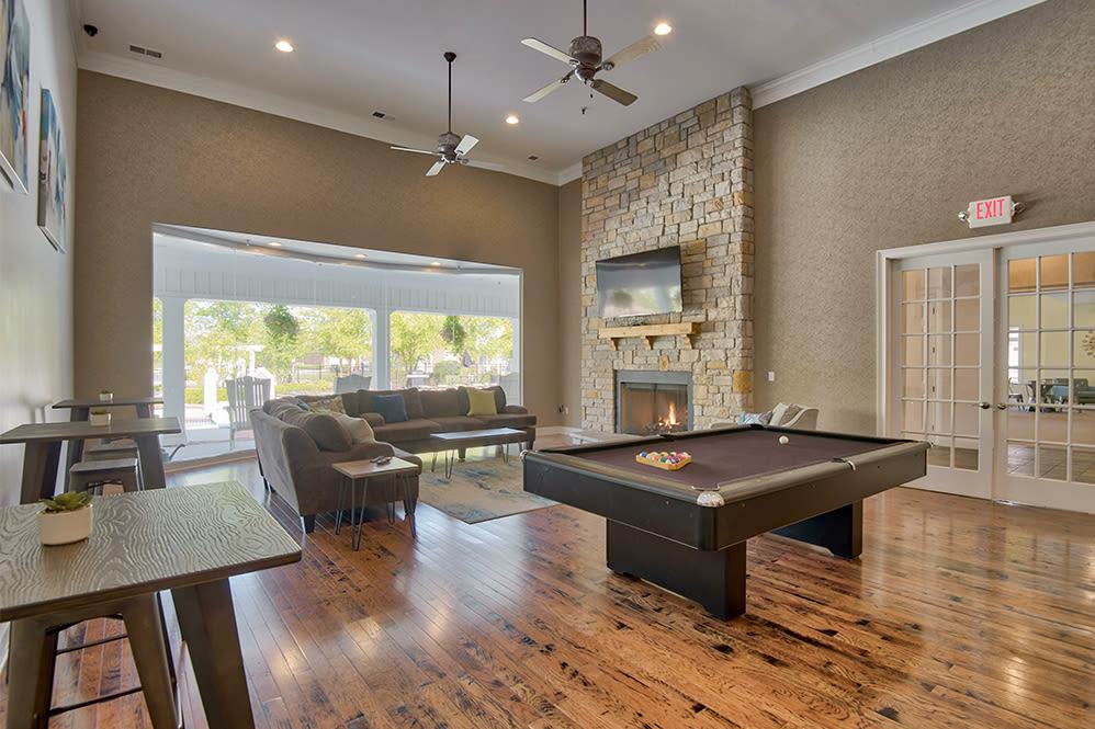 Community room with billiards table at Preston Gardens