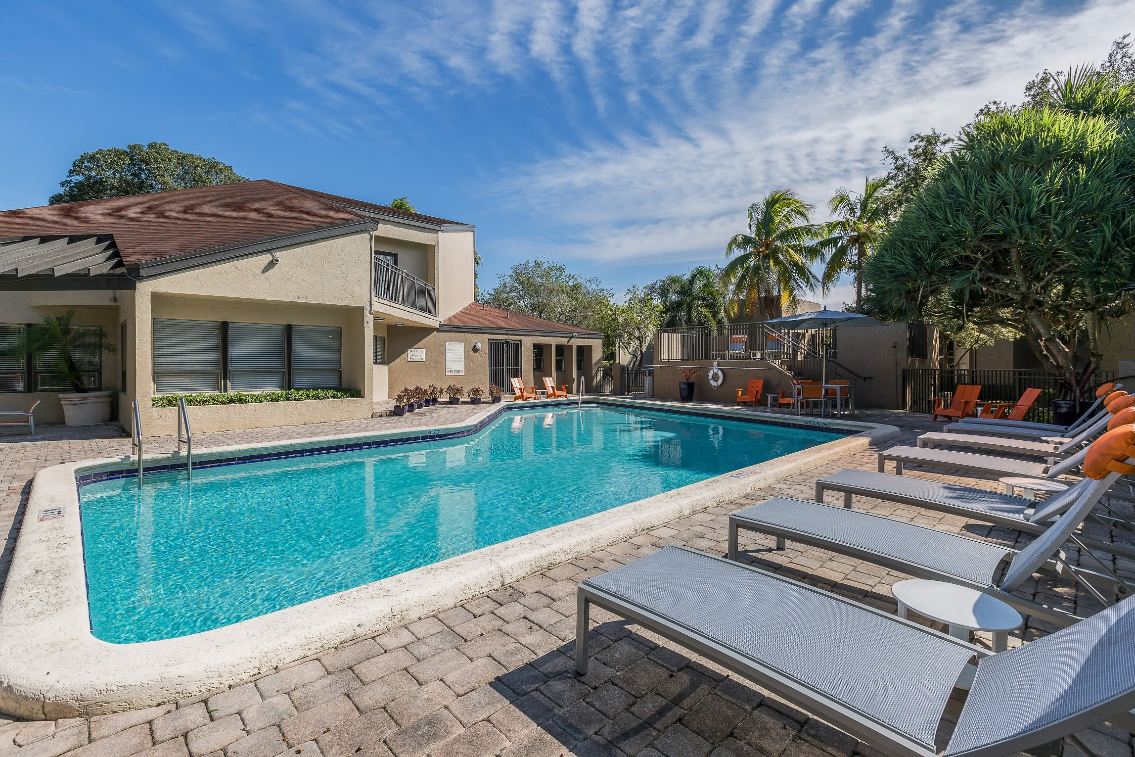Gorgeous swimming pool area on a beautiful day at Siena Apartments in Plantation, Florida