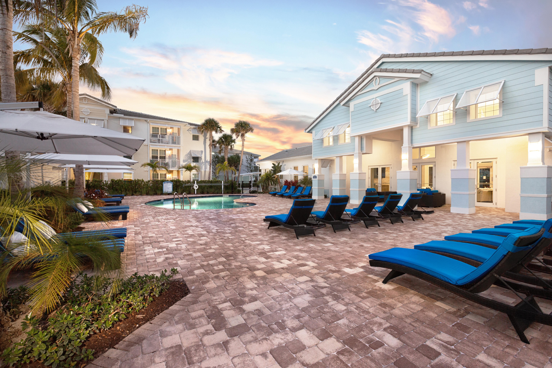 View of swimming pool outside of High Ridge Landing in Boynton Beach, Florida