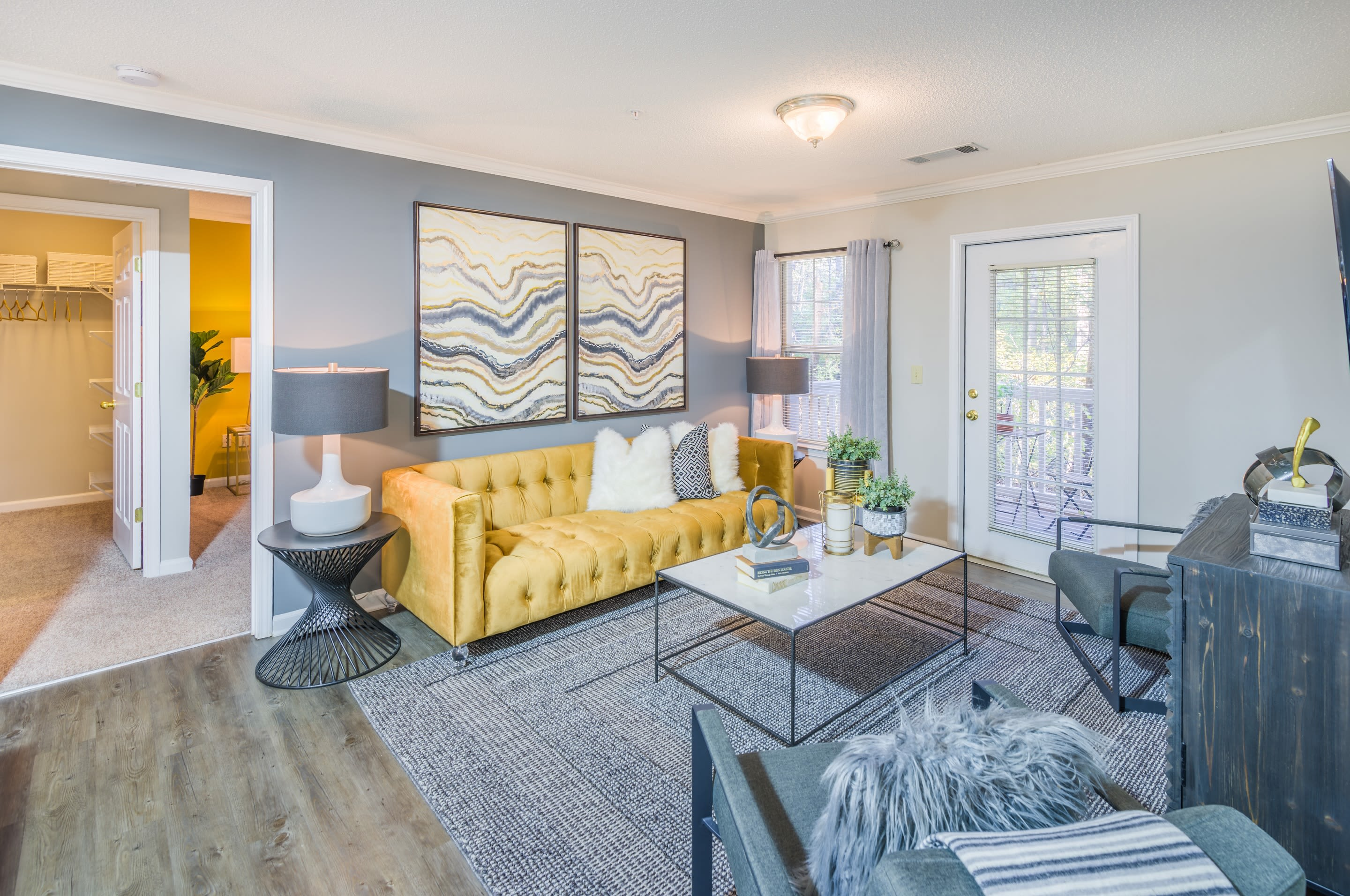 Open concept floor plan with hardwood floors and modern decor at The Oxford in Conyers, Georgia