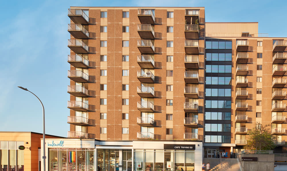 Halifax Apartments exterior shot of building and shopping