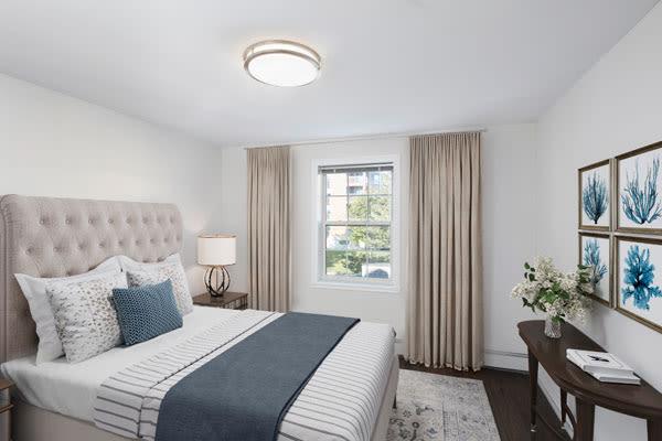 Enjoy a cozy bedroom at StoneCrest Village