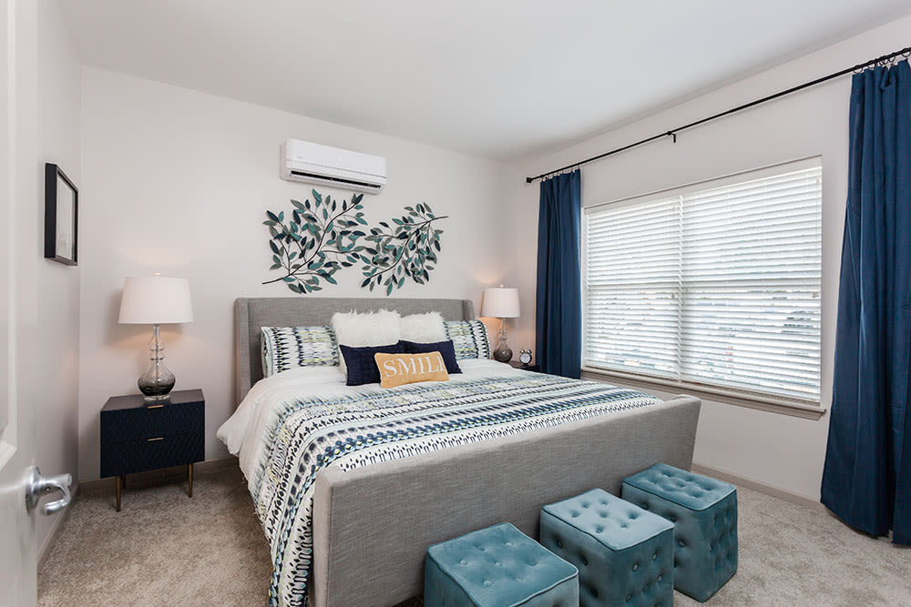 Bedroom with a view at Village Heights Senior Apartments in Fairport, New York