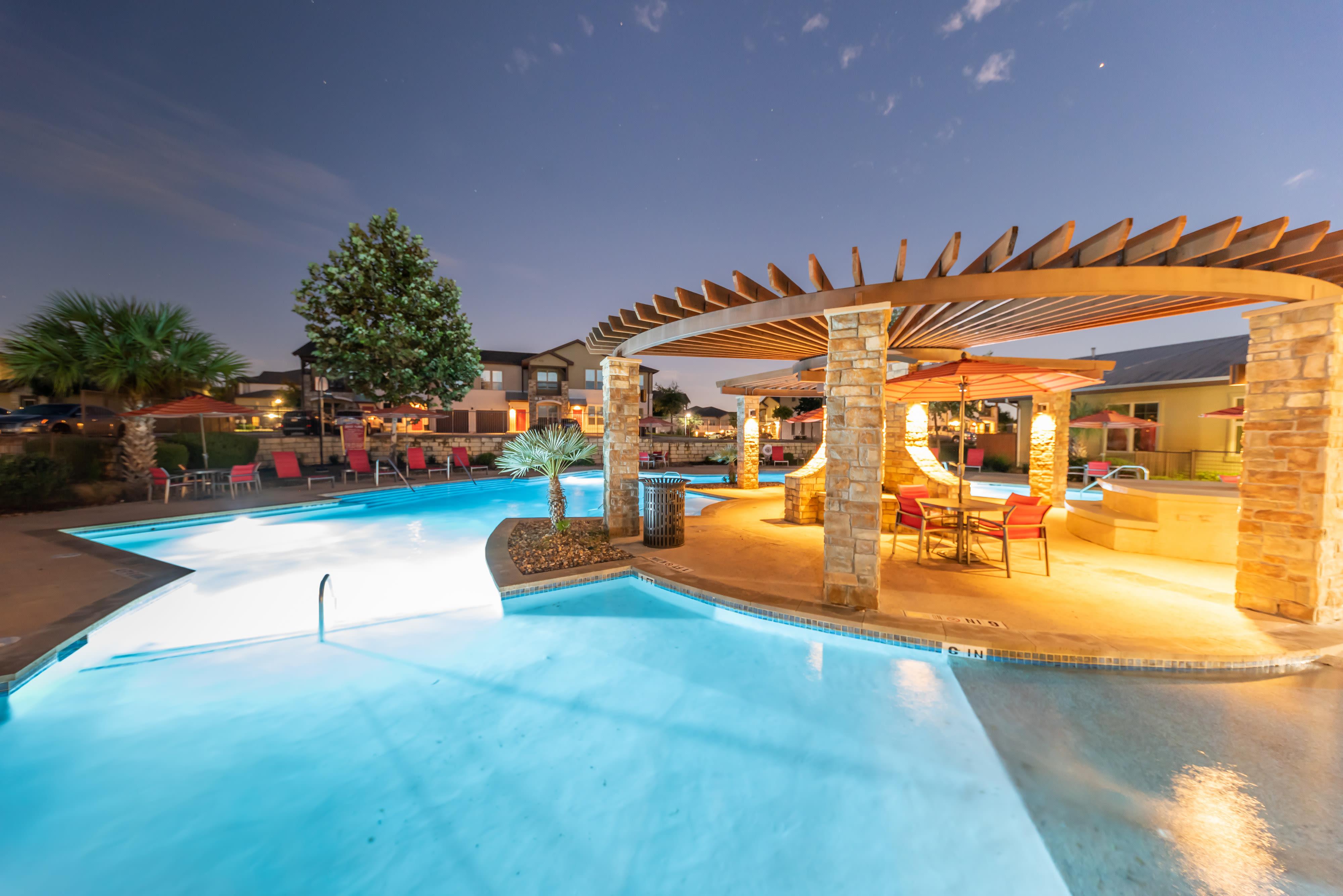 Night time outdoor pool display at Firewheel Apartments in San Antonio