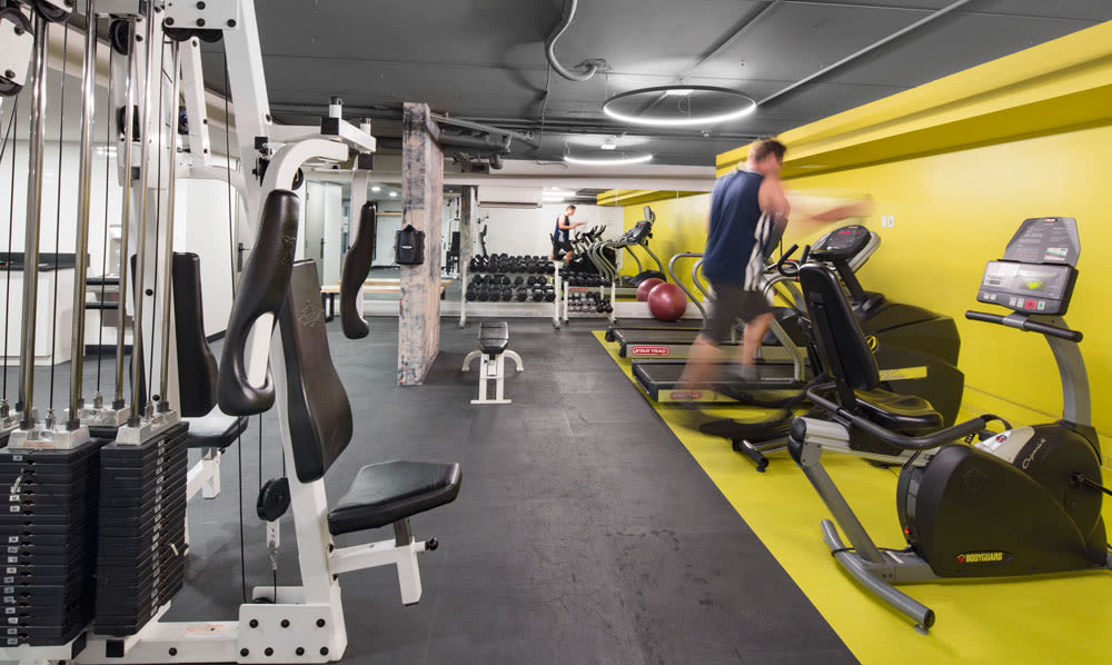 Modern and well-equipped fitness center in Royal View Apartments model home