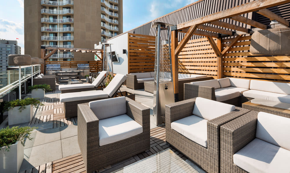 Rooftop patio with grill area at Park Square in Edmonton