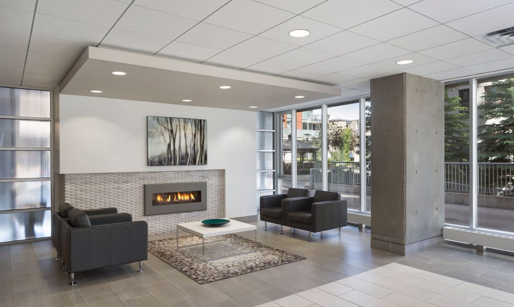 Lounge area with fireplace at Rouleau in Calgary, AB