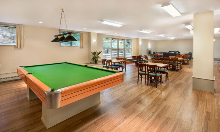 Pool table and clubhouse at Glenmore Gardens in Calgary, AB