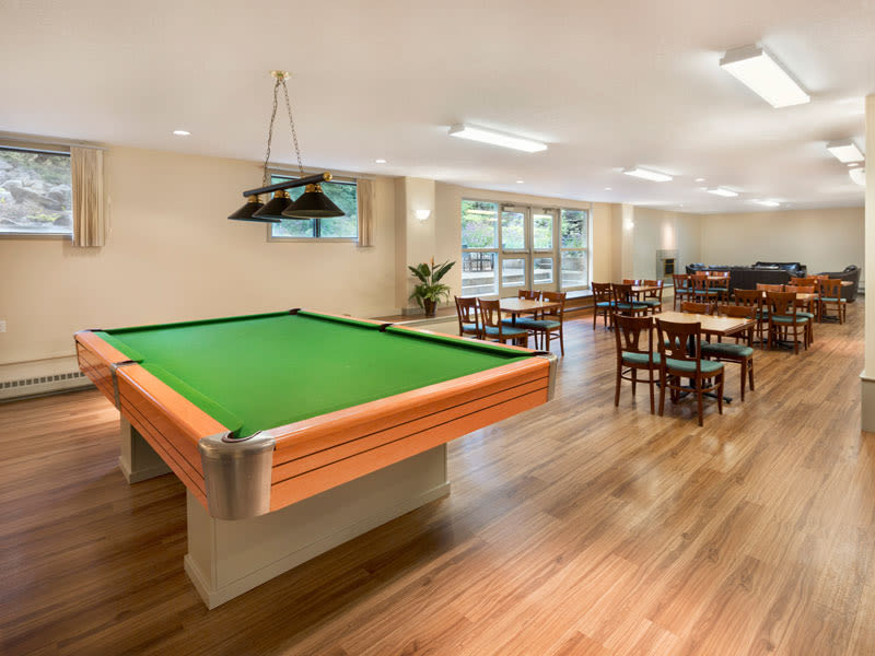 Pool table and clubhouse at Glenmore Gardens