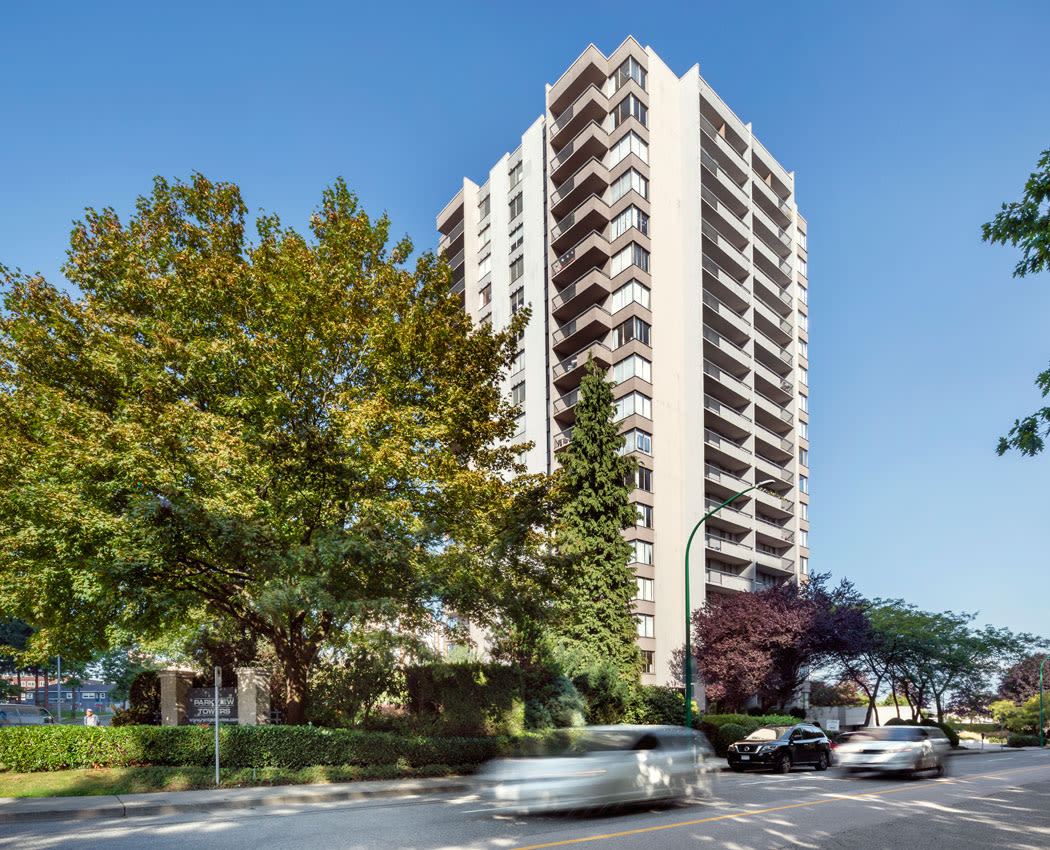 Exterior view of Parkview Towers and parking in Burnaby, BC