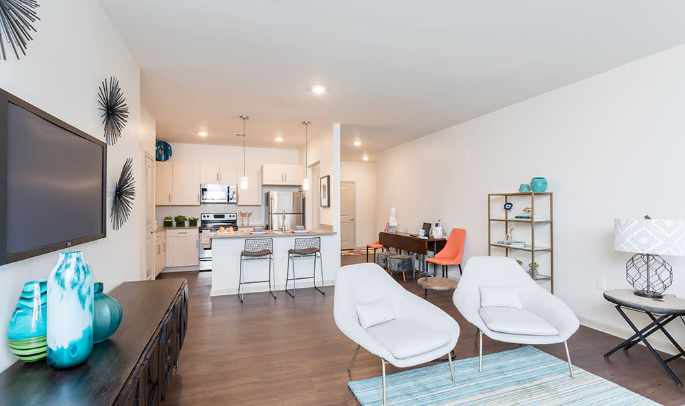 Living room and kitchen at Fairview at Town Center Apartment Homes are great for gatherings