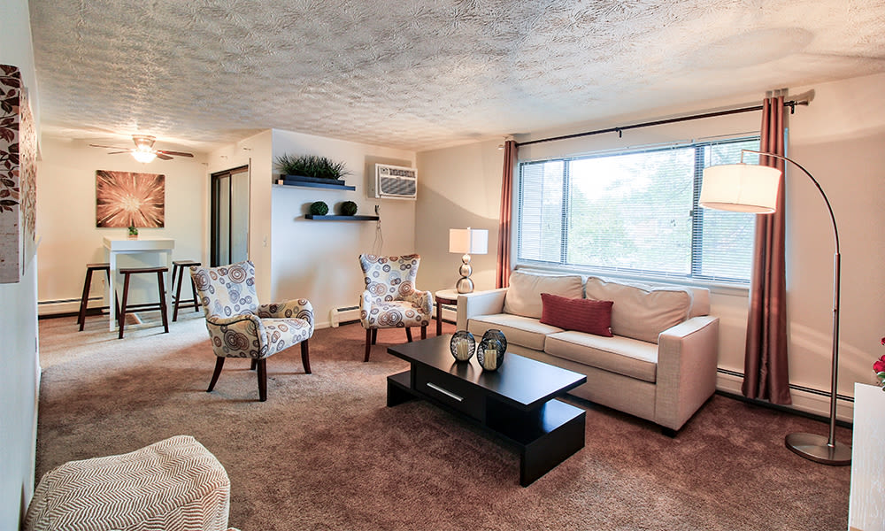 Spacious living room at Webster Manor Apartments in Webster, New York