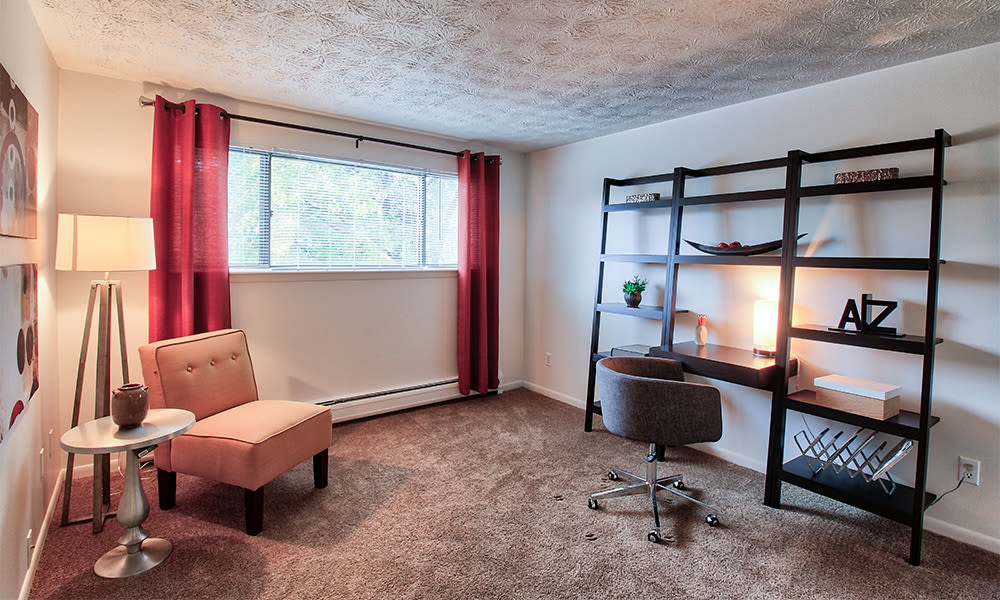 Enjoy a cozy bedroom at Webster Manor Apartments
