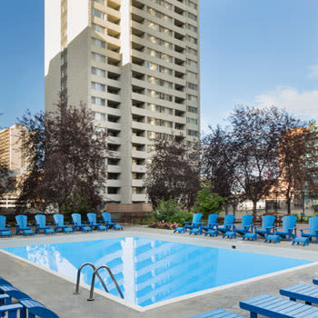 Outdoor swimming pool at Calgary Place Apartments in Calgary