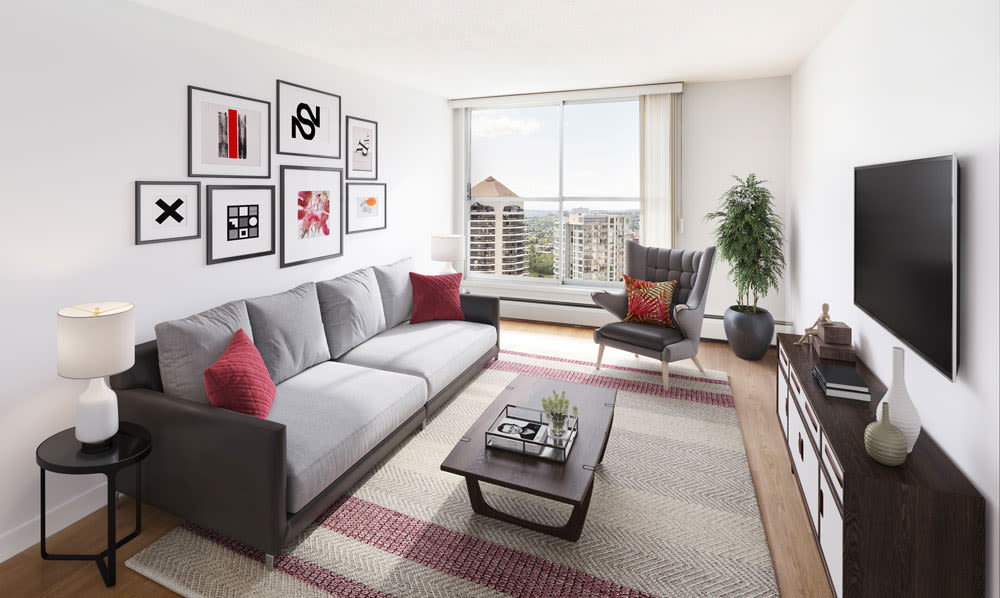 Spacious living room at Calgary Place Apartments in Calgary, Alberta