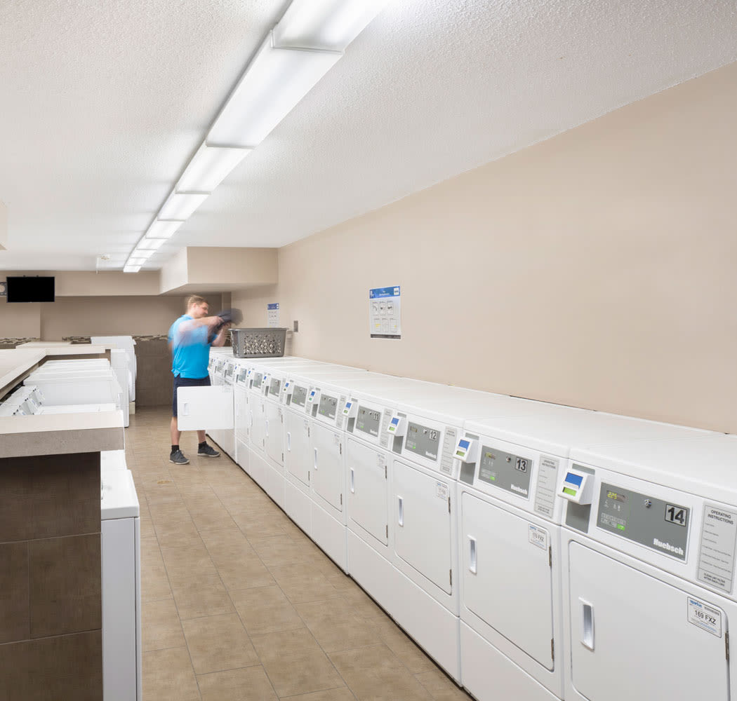 On-site laundry facility at Calgary Place Apartments in Calgary, AB