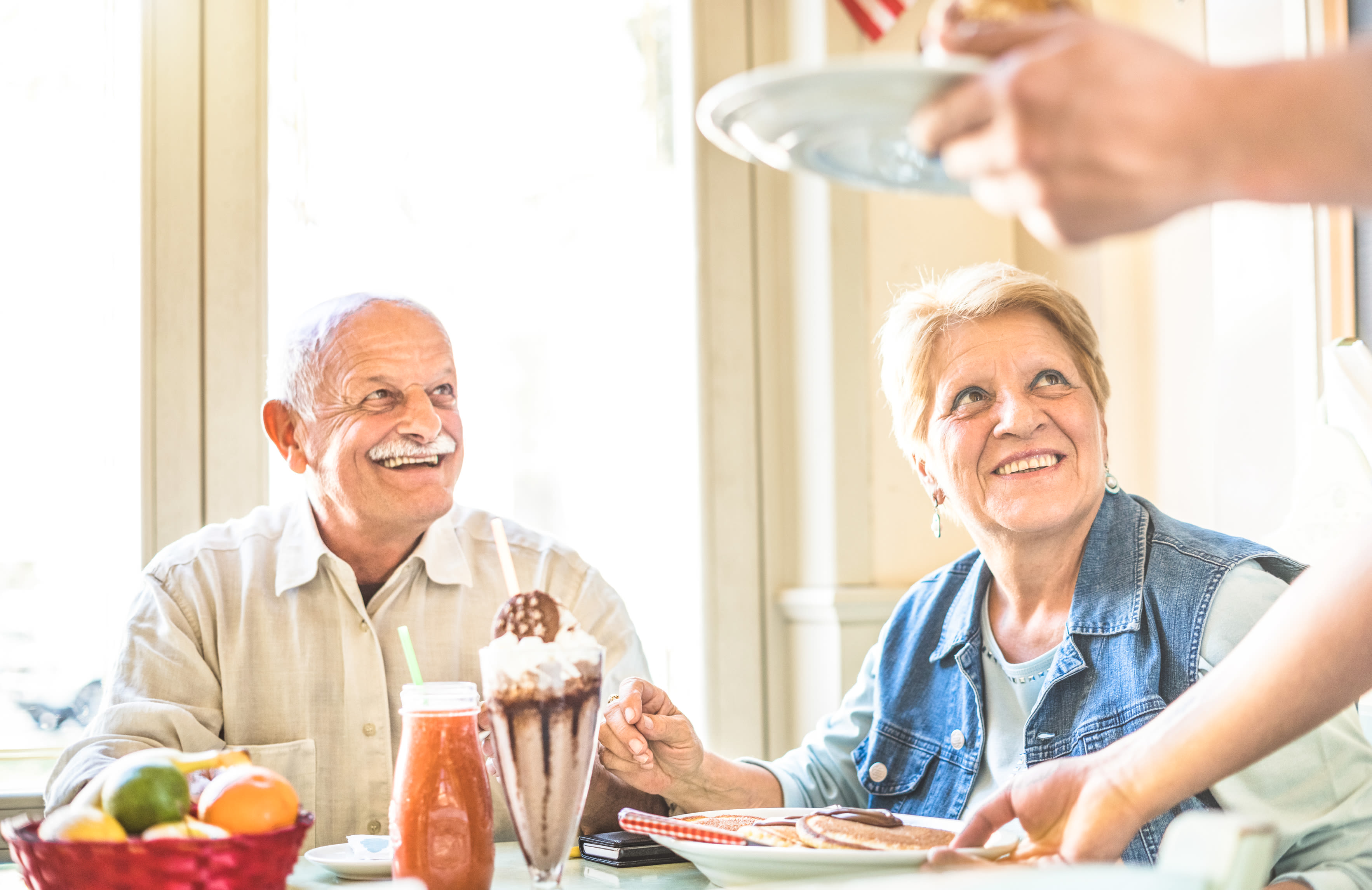Senior couple having a meal at Almond Heights in Orangevale, California