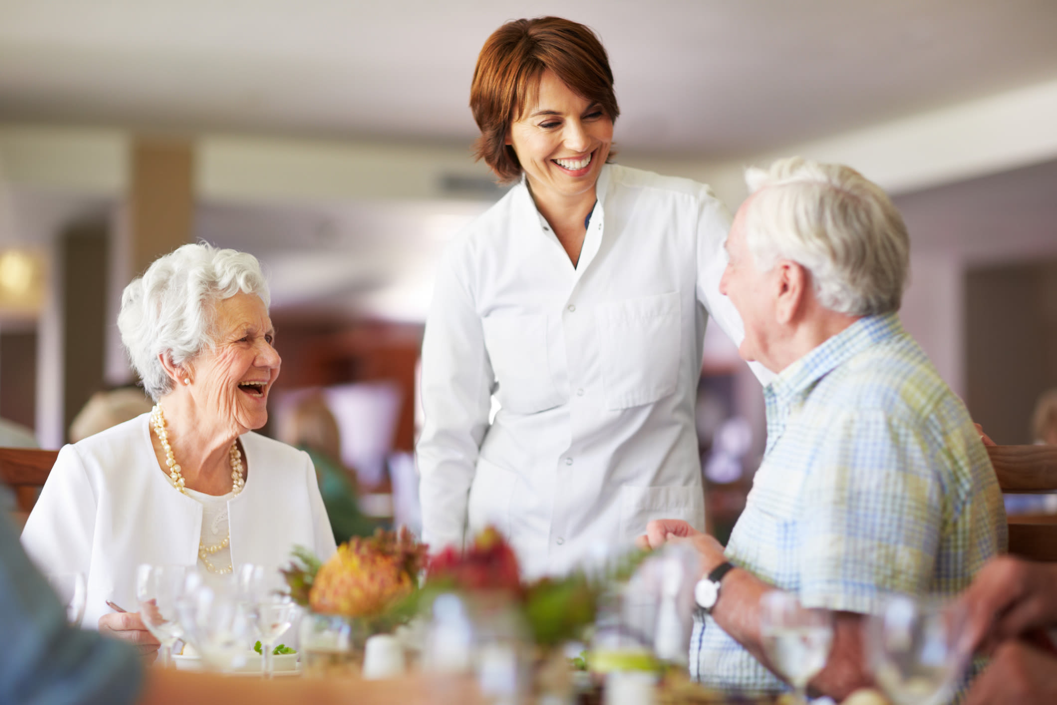 A server speaking with residents at Almond Heights in Orangevale, California