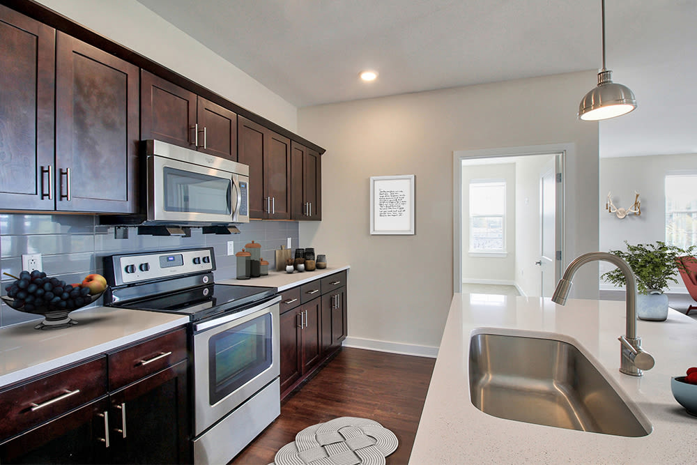 Well-equipped kitchen and breakfast bar at Pinnacle North Apartments in Canandaigua