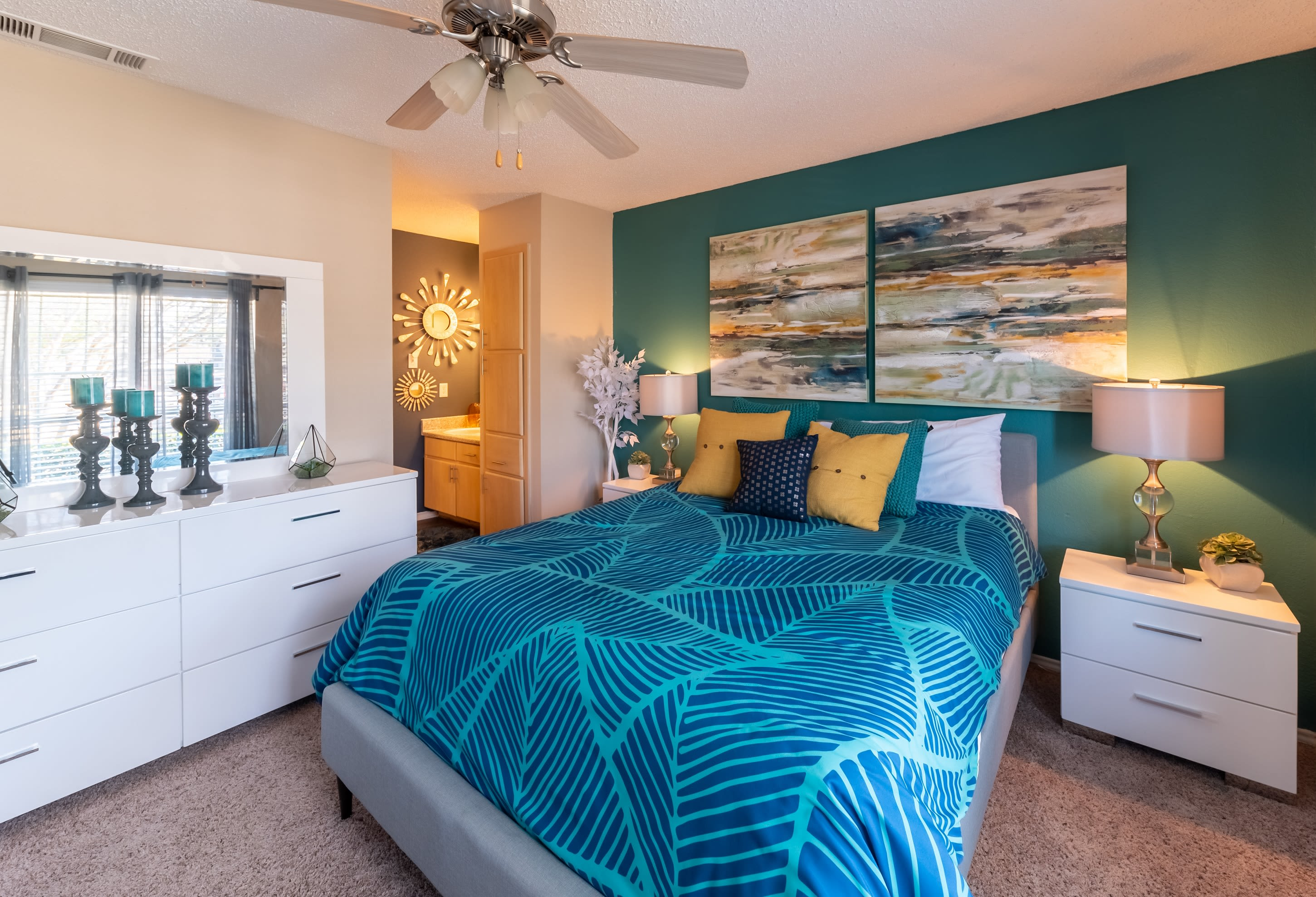 Well-decorated bedroom in model home at Village Green of Bear Creek in Euless, Texas