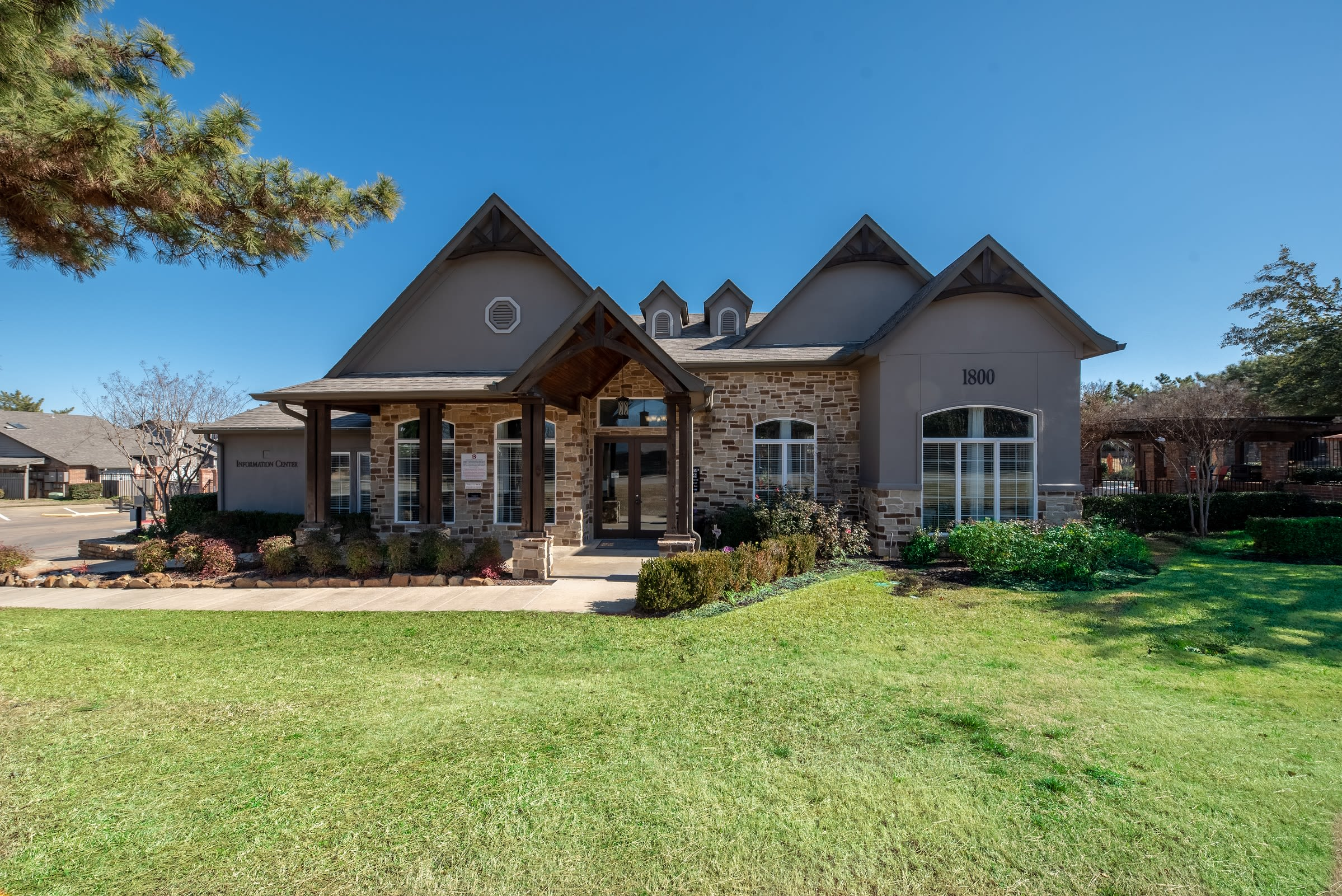 Well manicured exterior landscape at Village Green of Bear Creek in Euless, Texas