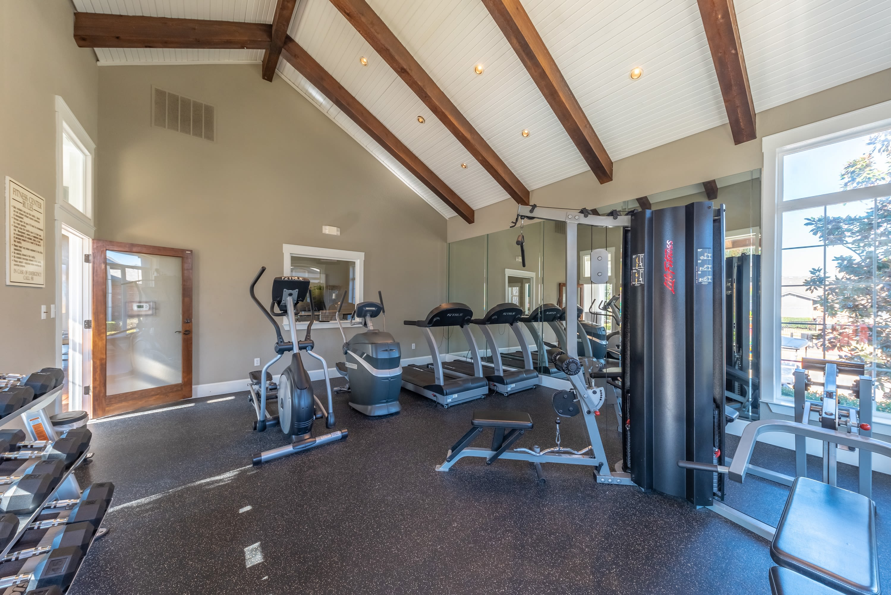 Well equipped fitness center at Village Green of Bear Creek in Euless, Texas