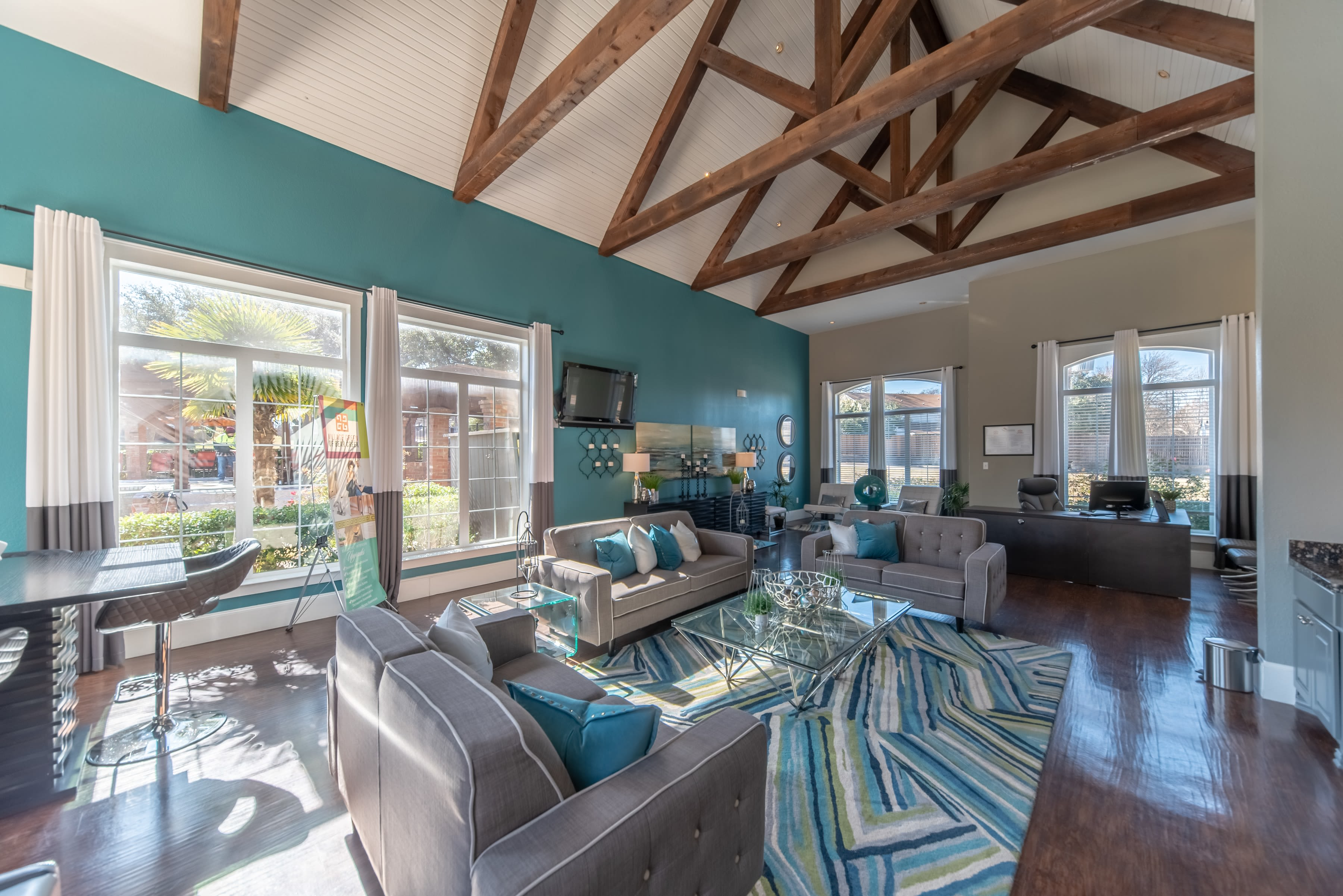 Clubhouse with amenities poolside at Village Green of Bear Creek in Euless, Texas