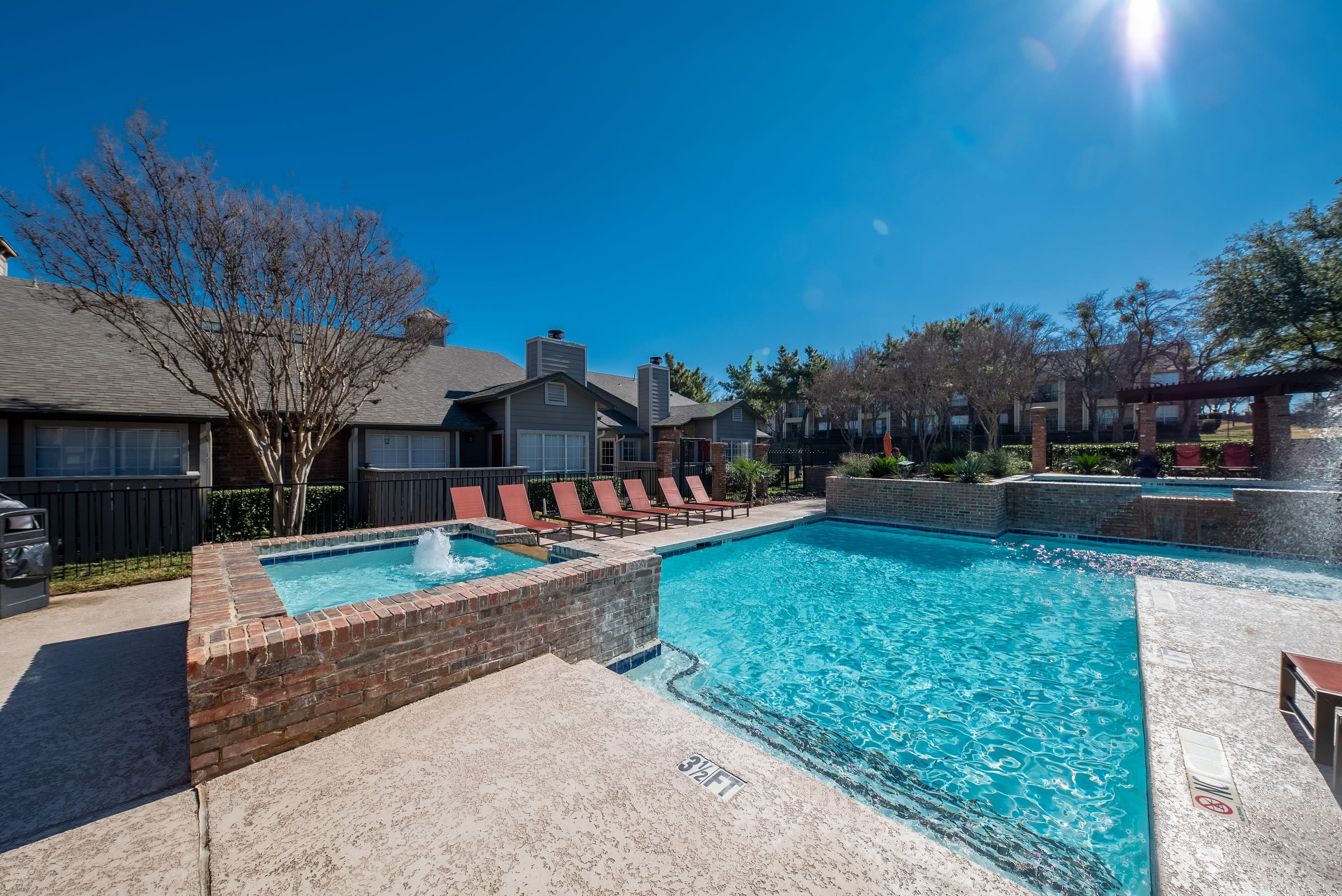 Sunny pool view at Village Green of Bear Creek in Euless, Texas