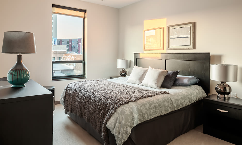 Eastside Bond Apartments offers a cozy bedroom in Pittsburgh, PA
