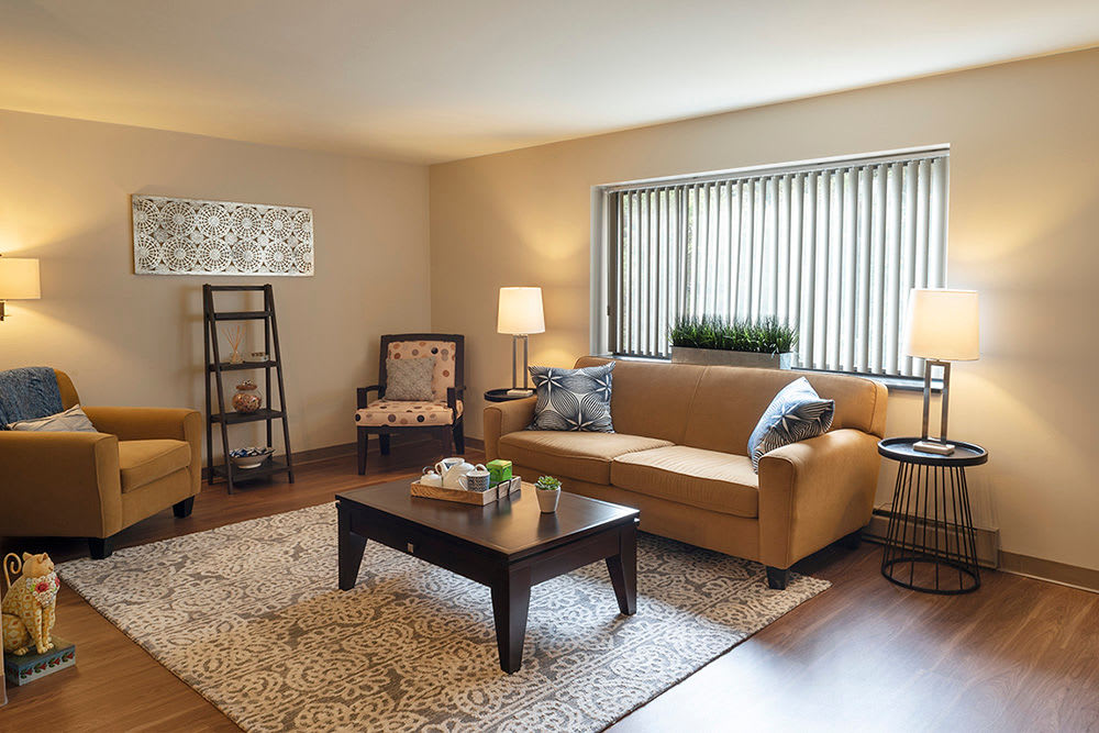 Cozy living room at Maiden Bridge and Canongate Apartments in Pittsburgh, Pennsylvania