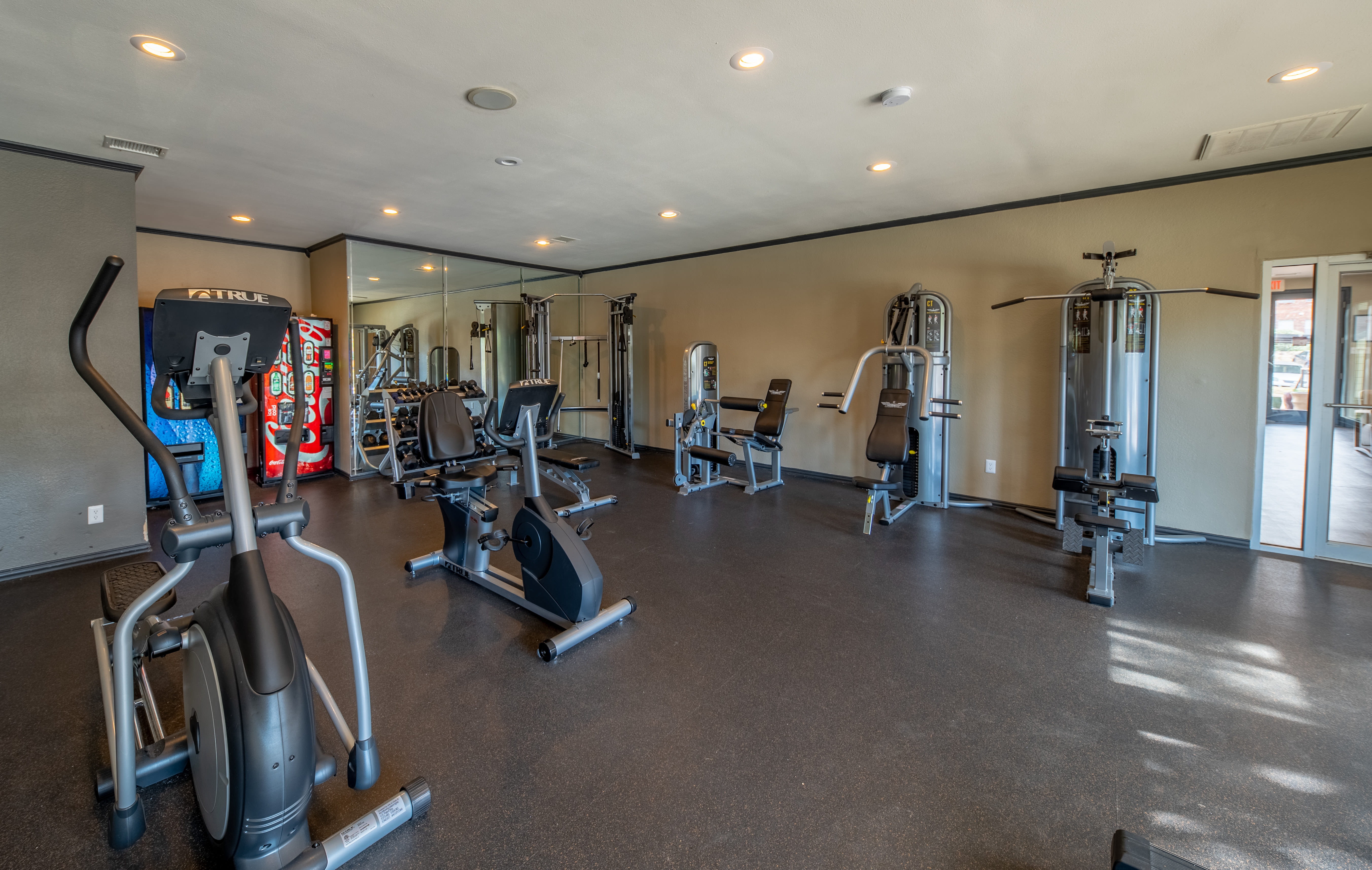 Well-equipped fitness center at Trails of Towne Lake in Irving, Texas