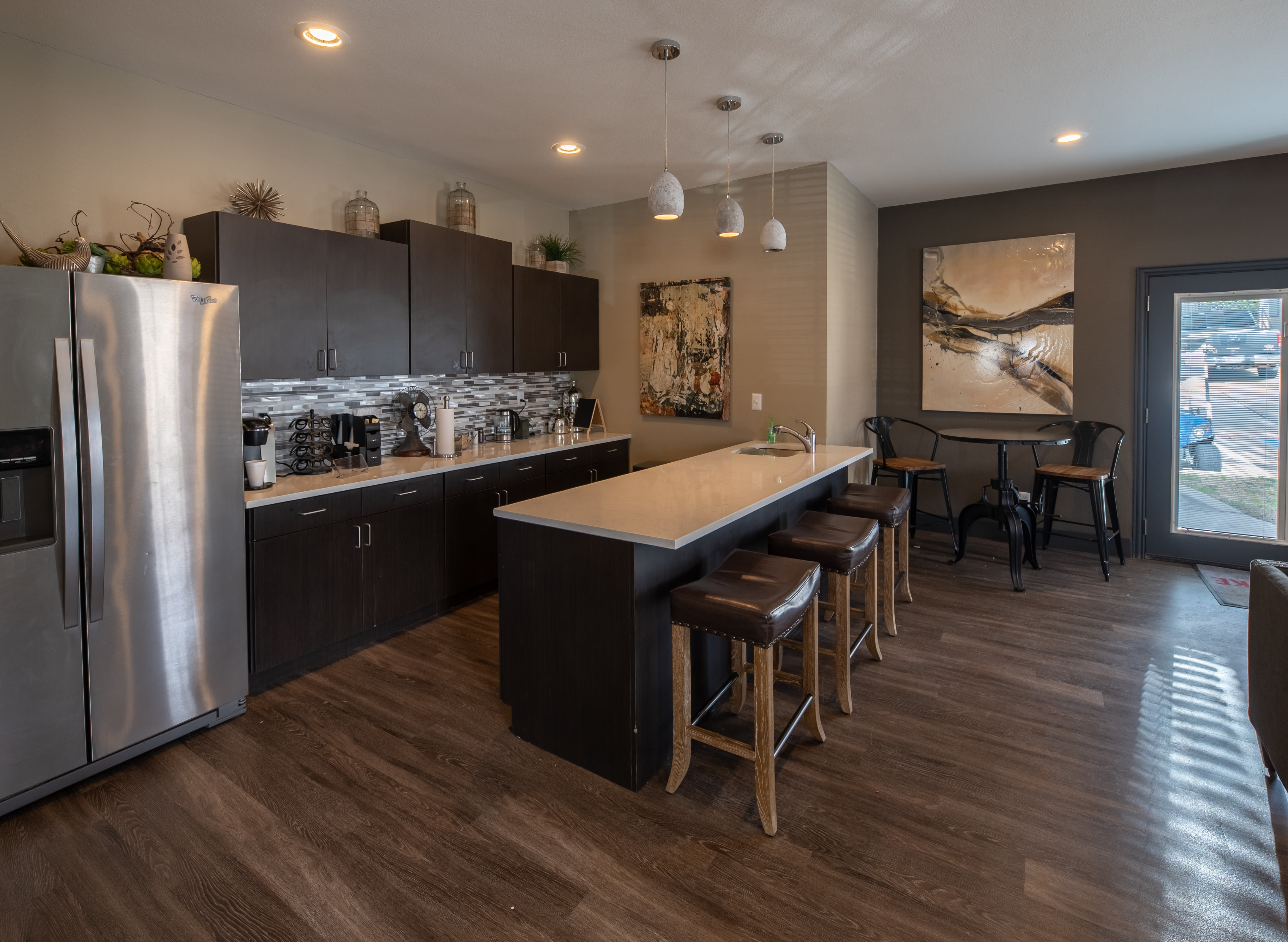 Modern kitchen with stainless steel appliances and granite countertops at Trails of Towne Lake in Irving, Texas