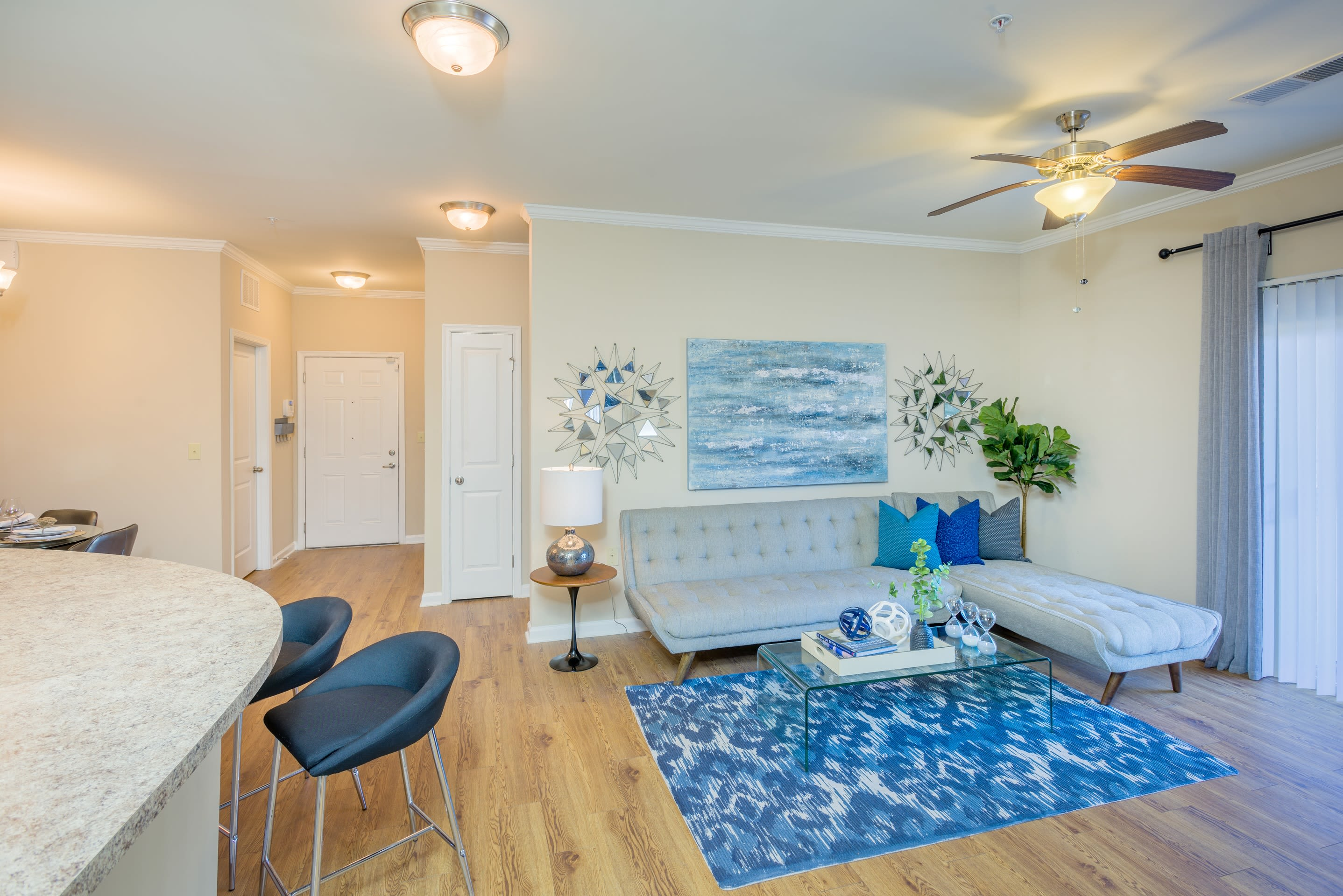 Apartment interior with hardwood flooring at Arbor Village in Summerville, South Carolina