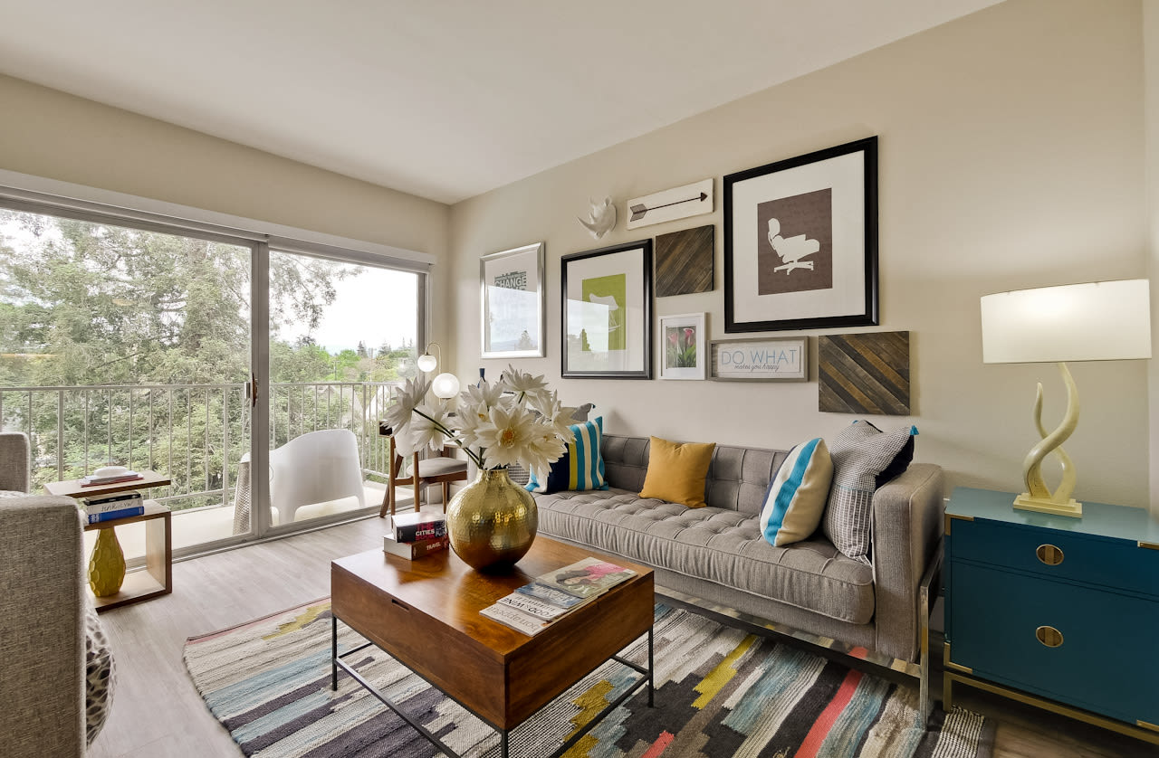 Enjoy the studio apartment living room at Mia in Palo Alto, CA