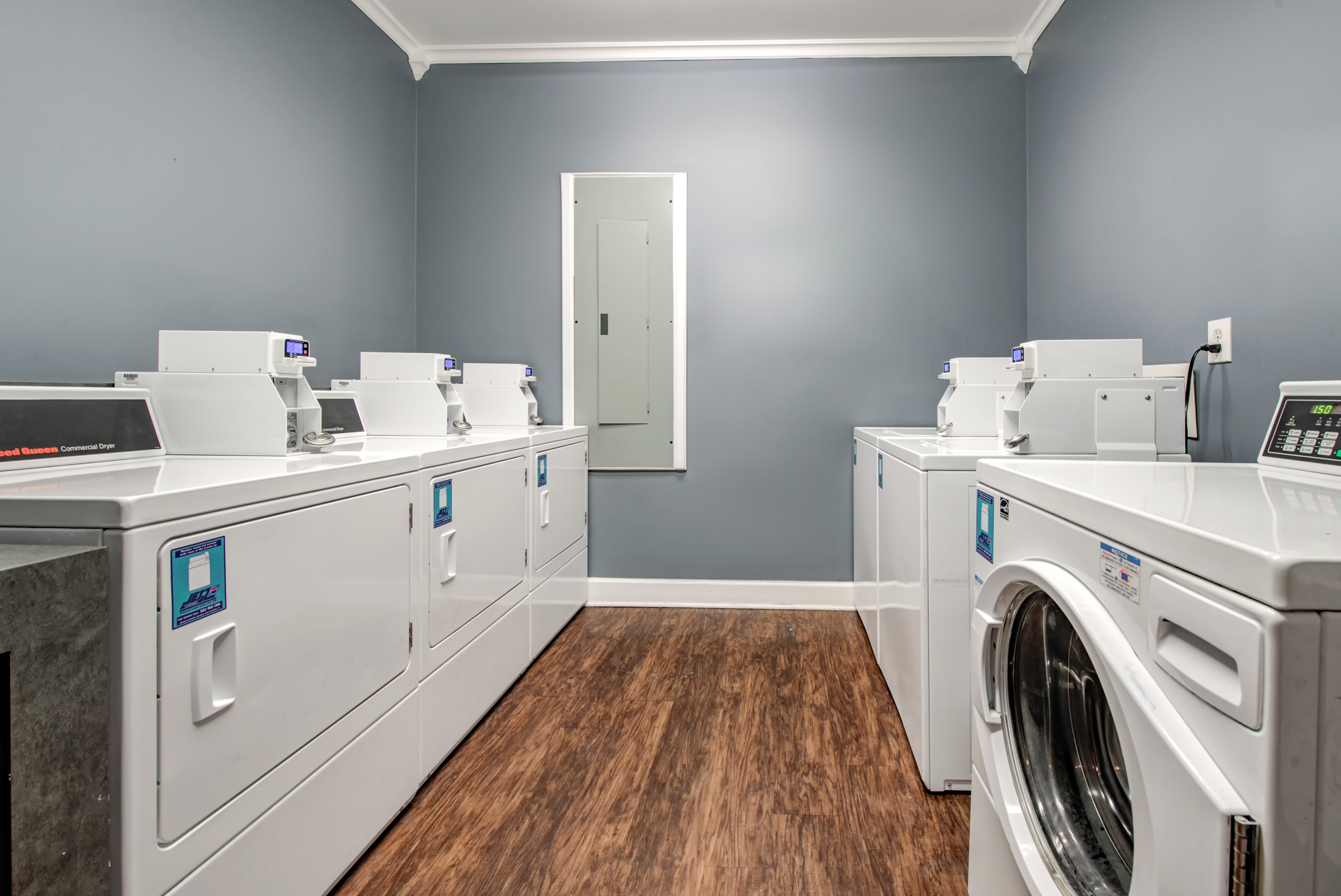 Laundry room with multiple machines at Renaissance St. Andrews in Louisville, Kentucky.
