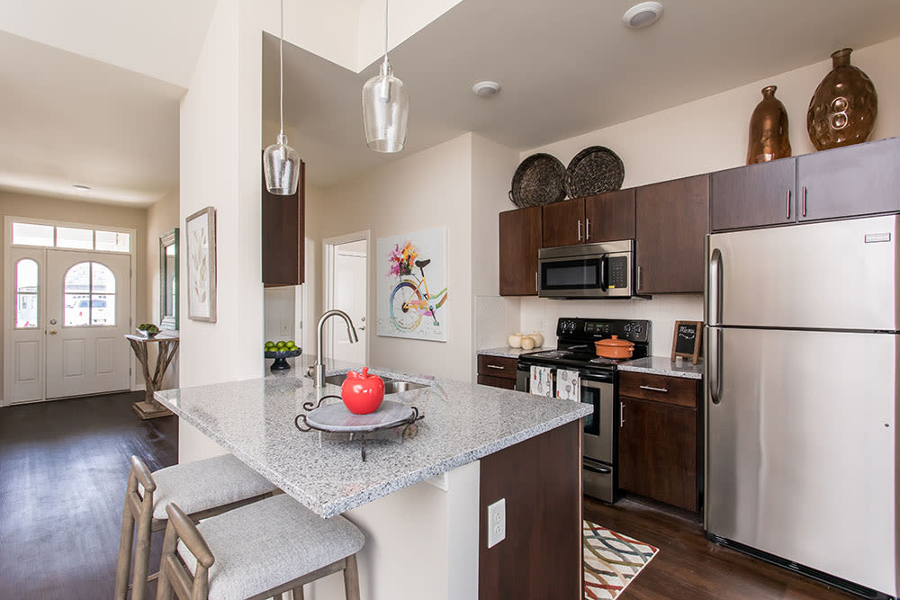 Well-equipped kitchen at Orchard View Senior Apartments home