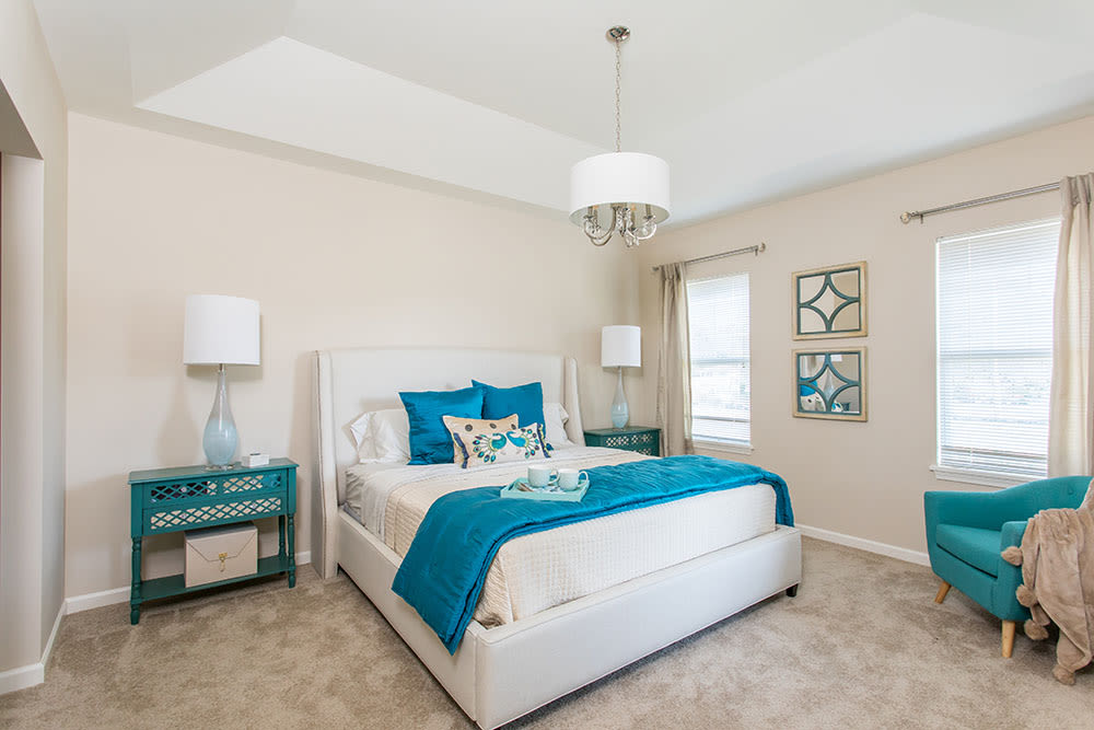 Well decorated bedroom at Orchard View Senior Apartments home