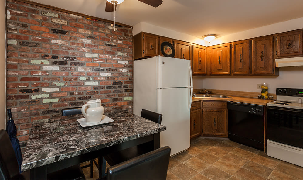 Kitchen and dining table at Raintree Island Apartments in Tonawanda, NY