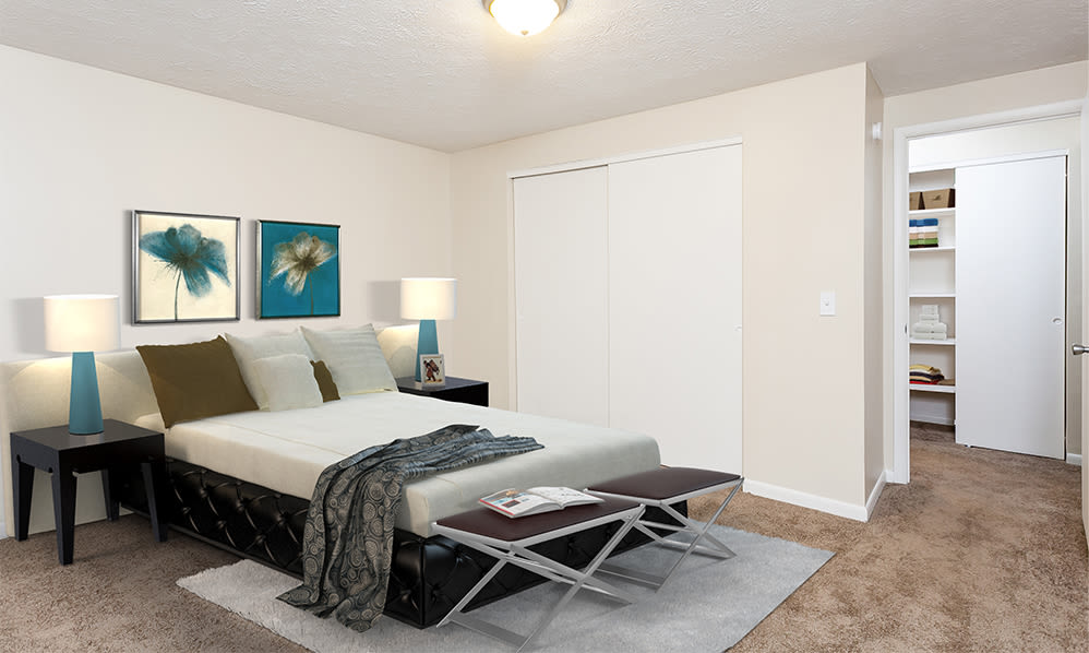 Comfy bed at Willowbrooke Apartments and Townhomes home in Brockport, New York