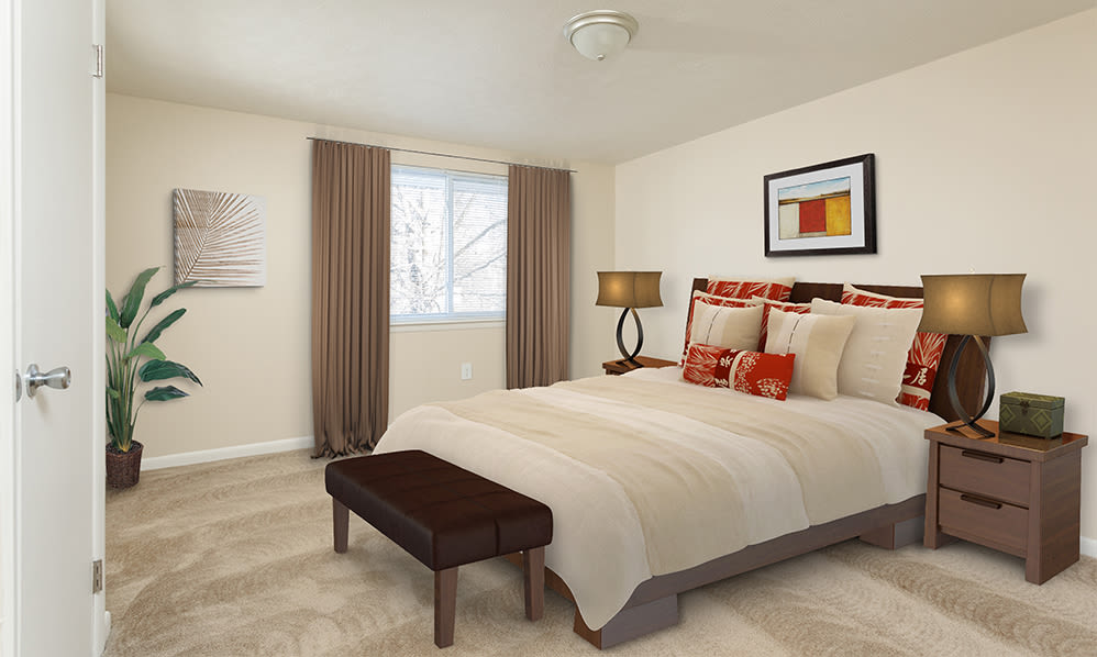 Well decorated bedroom at Willowbrooke Apartments and Townhomes home in Brockport, New York