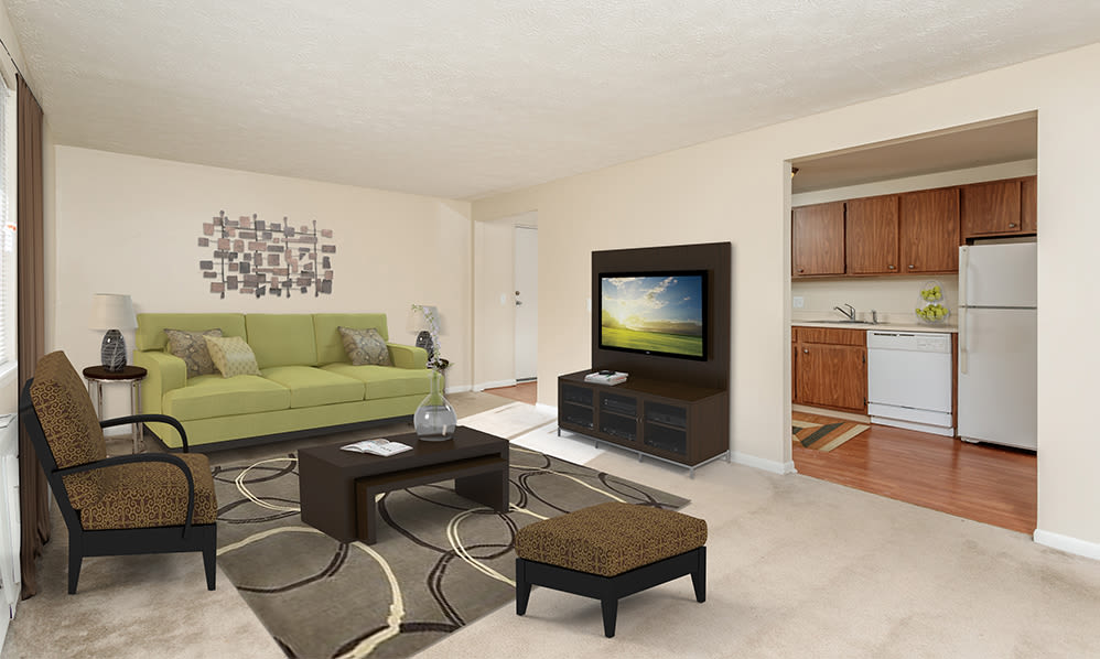 Spacious living room at Willowbrooke Apartments and Townhomes in Brockport, New York