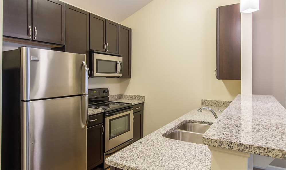 Well-equipped kitchen at Ethan Pointe Apartments home in Rochester, NY
