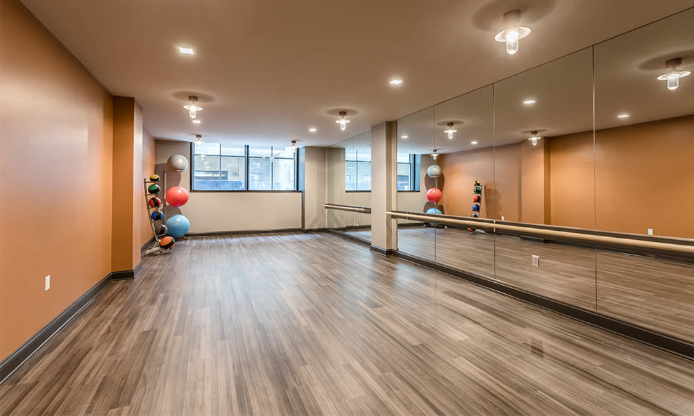 Modern fitness center at apartments in Rochester, New York