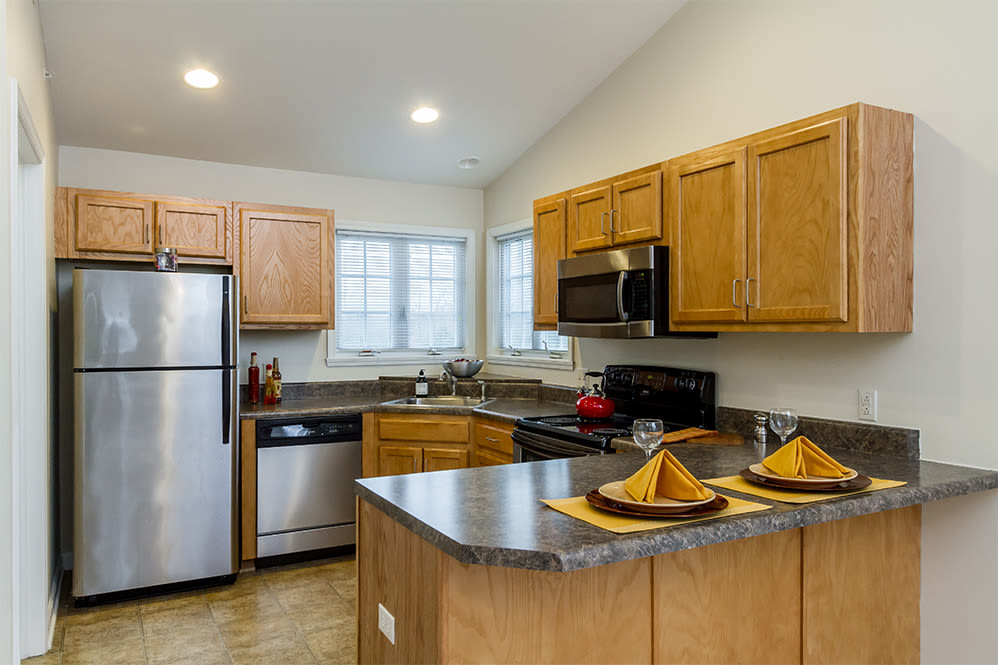Well-equipped kitchen at Villas of Victor & Regency Townhomes in Victor, New York